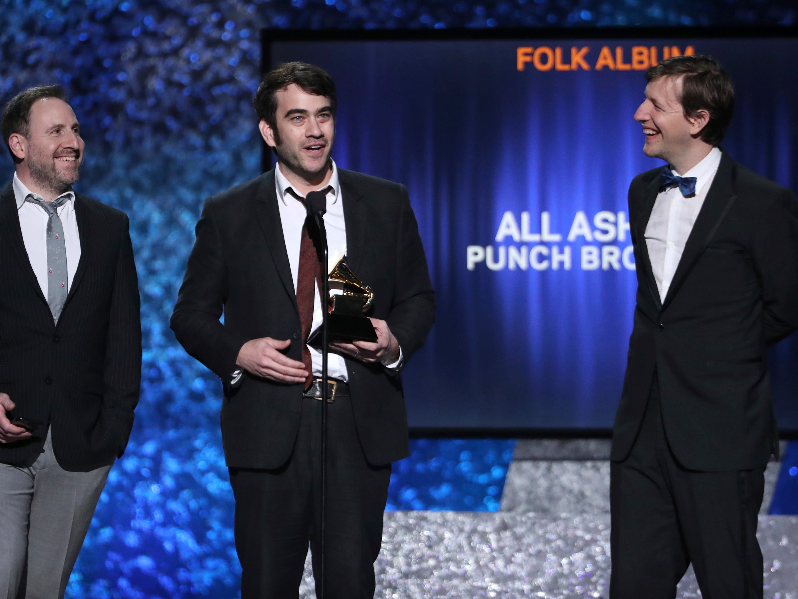 "Gabe Witcher, from left, Noam Pikelny and Chris Eldridge of ""The Punch Brothers"" accept the award for best folk album for ""All Ashore"" at the 61st annual Grammy Awards on Sunday, Feb. 10, 2019, in Los Angeles."