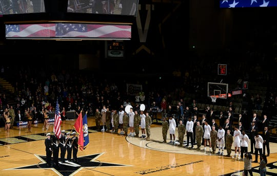 Vanderbilt players stand with members of the 101st Airborne before their game against the Alabama at Memorial Gym Saturday Feb. 9, 2019 in Nashville, Tenn.