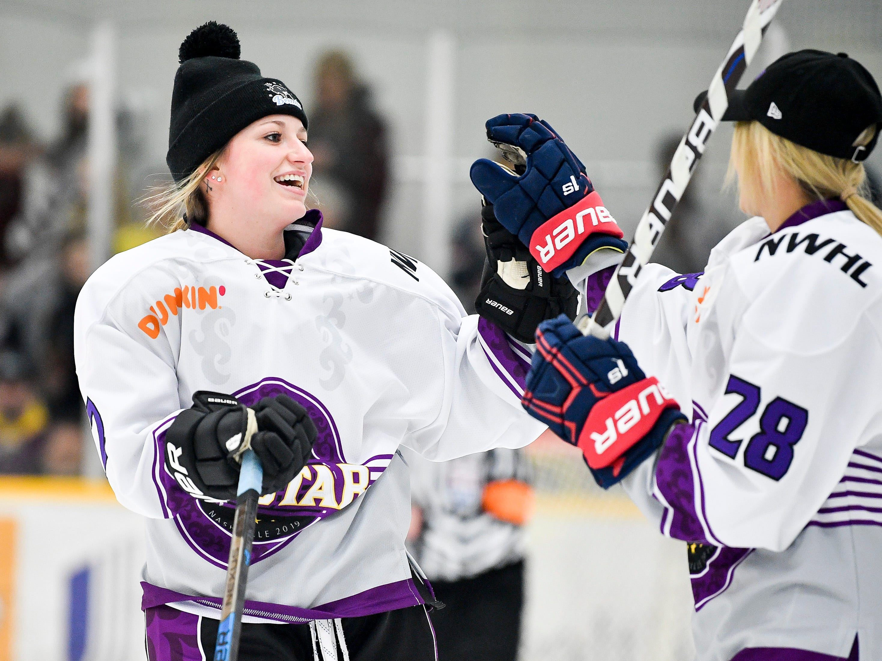 Savannah Harmon, left, reacts with Amanda Kessel after competing in the shooting accuracy competition during the 2019 NWHL All-Star Weekend Skills Competition at Ford Ice Center in Antioch, Tenn., Saturday, Feb. 9, 2019.
