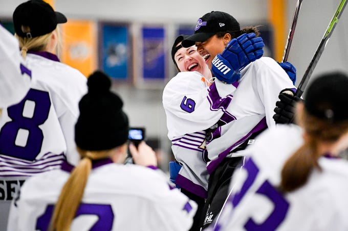 Blake Bolden reacts with Shannon Doyle (6) competing in the during the hardest shot competition 2019 NWHL All-Star Weekend Skills Competition at Ford Ice Center in Antioch, Tenn., Saturday, Feb. 9, 2019.