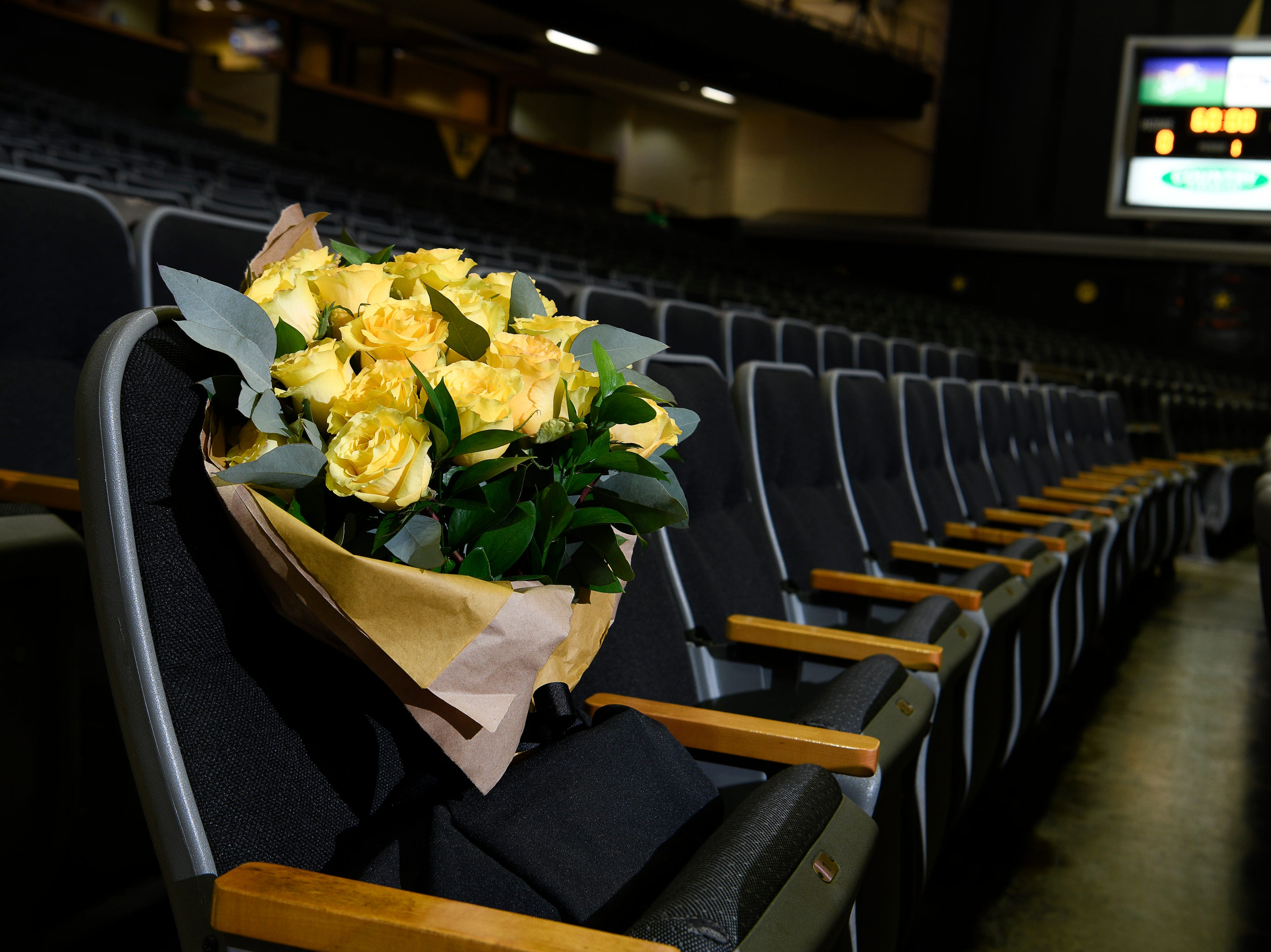Yellow roses honor Vanderbilt's former athletic director David Williams in his seat at Memorial Gym before their game against tAlabama Saturday Feb. 9, 2019 in Nashville, Tenn. Williams passed away suddenly on Friday morning.