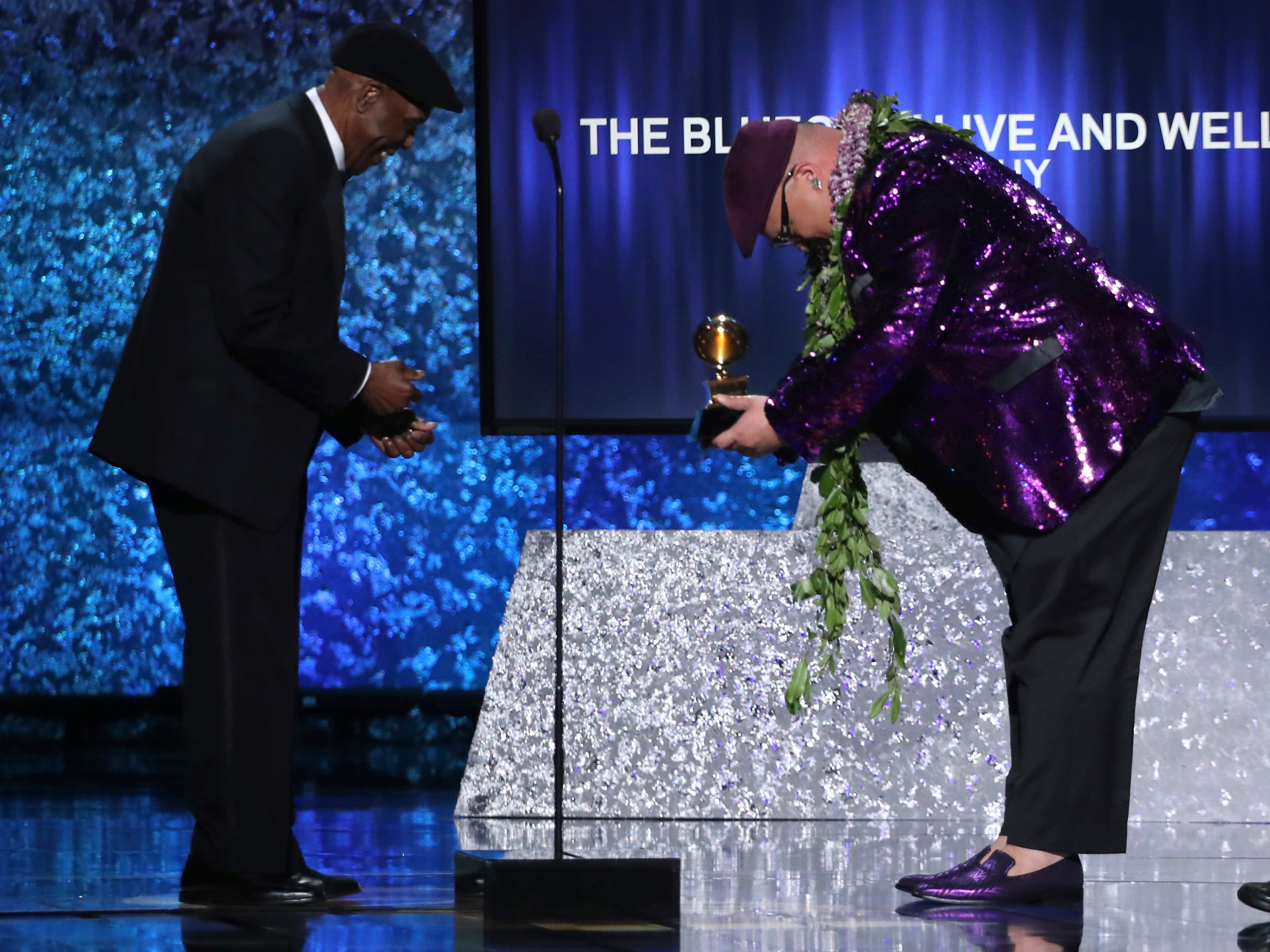 "Kalani Pe'a, right, presents Buddy Guy with the award for best traditional blues album for ""The Blues Is Alive and Well"" at the 61st annual Grammy Awards on Sunday, Feb. 10, 2019, in Los Angeles."