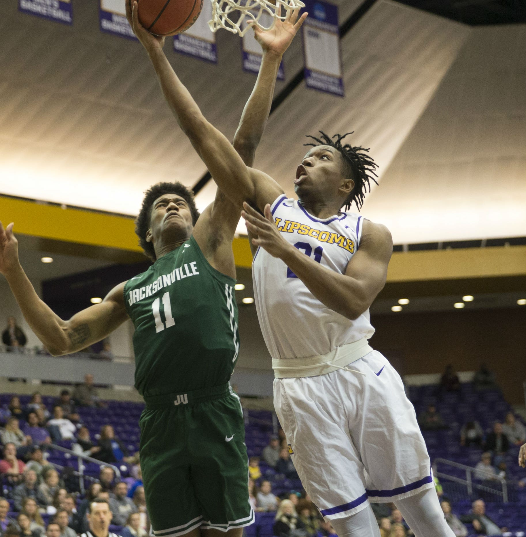 Lipscomb's Kenny Cooper (21) puts up a shot against Jacksonville's Jalyn Hinton (11) in Saturday's game at Allen Arena.