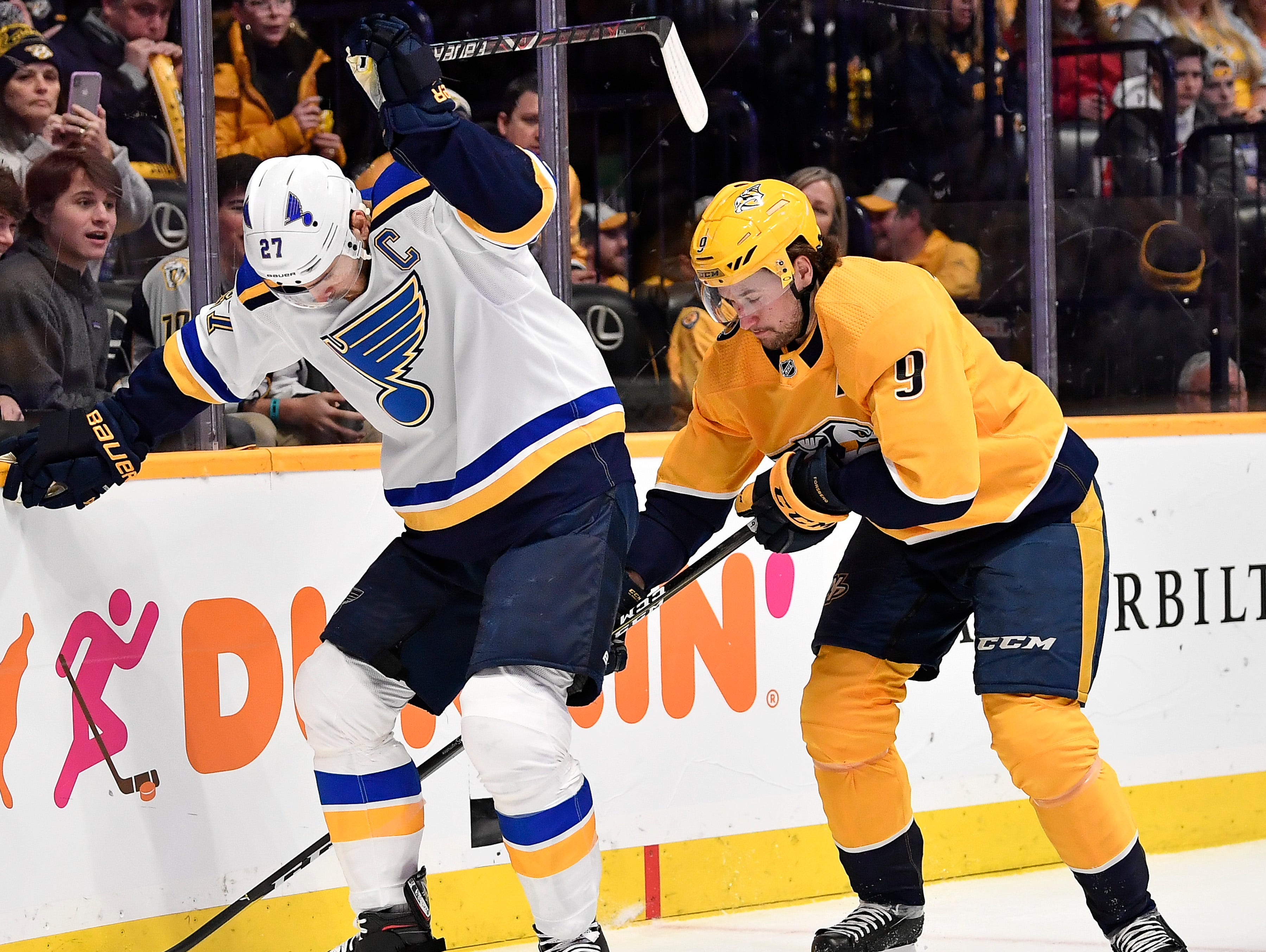 Predators left wing Filip Forsberg (9) tries to get the puck from Blues defenseman Alex Pietrangelo (27) during the first period at Bridgestone Arena Sunday Feb. 10, 2019 in Nashville, Tenn.