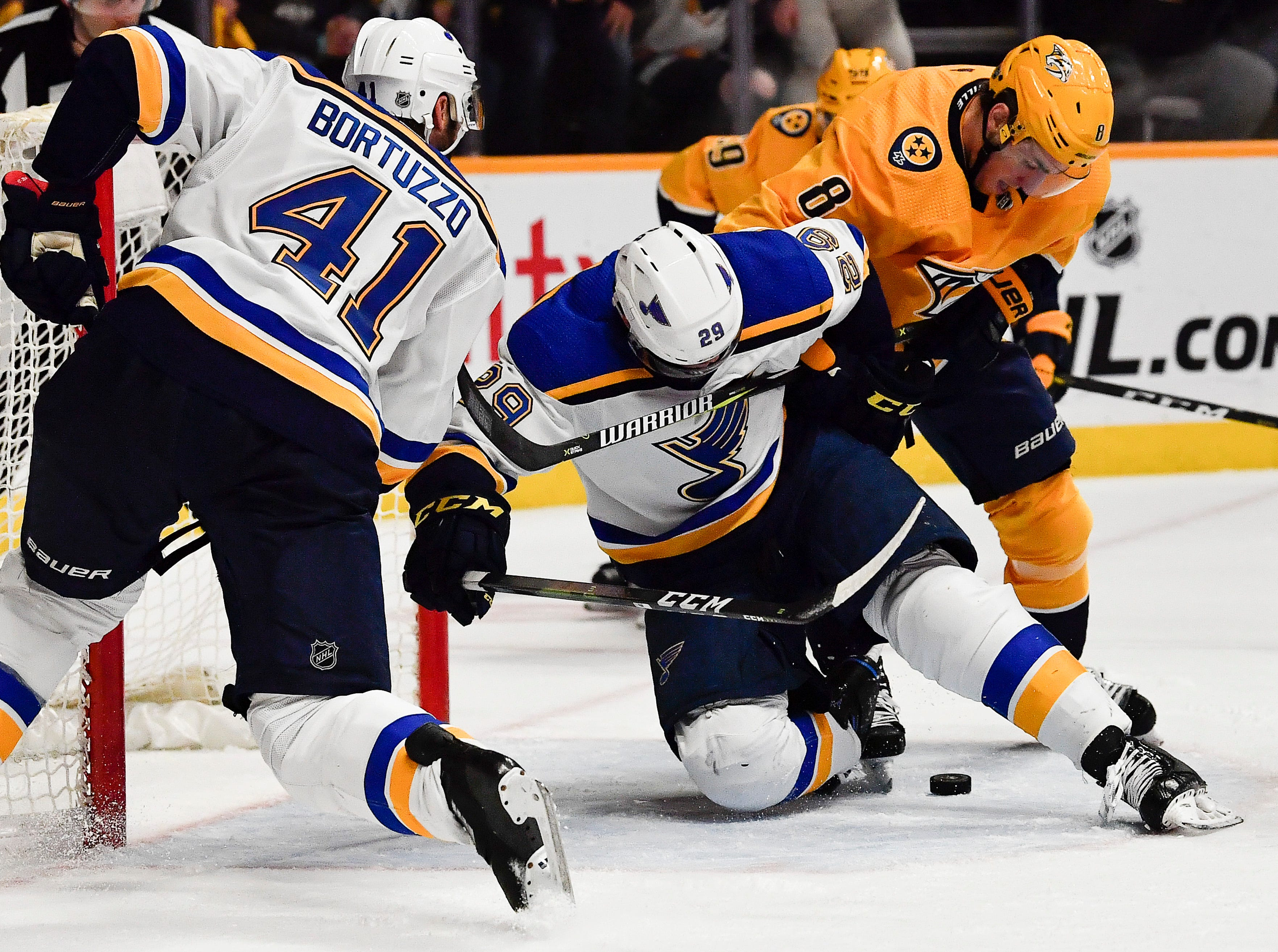 Predators center Kyle Turris (8) fights to shoot the puck past Blues defenseman Robert Bortuzzo (41) and defenseman Vince Dunn (29) during the third period at Bridgestone Arena Sunday Feb. 10, 2019 in Nashville, Tenn.