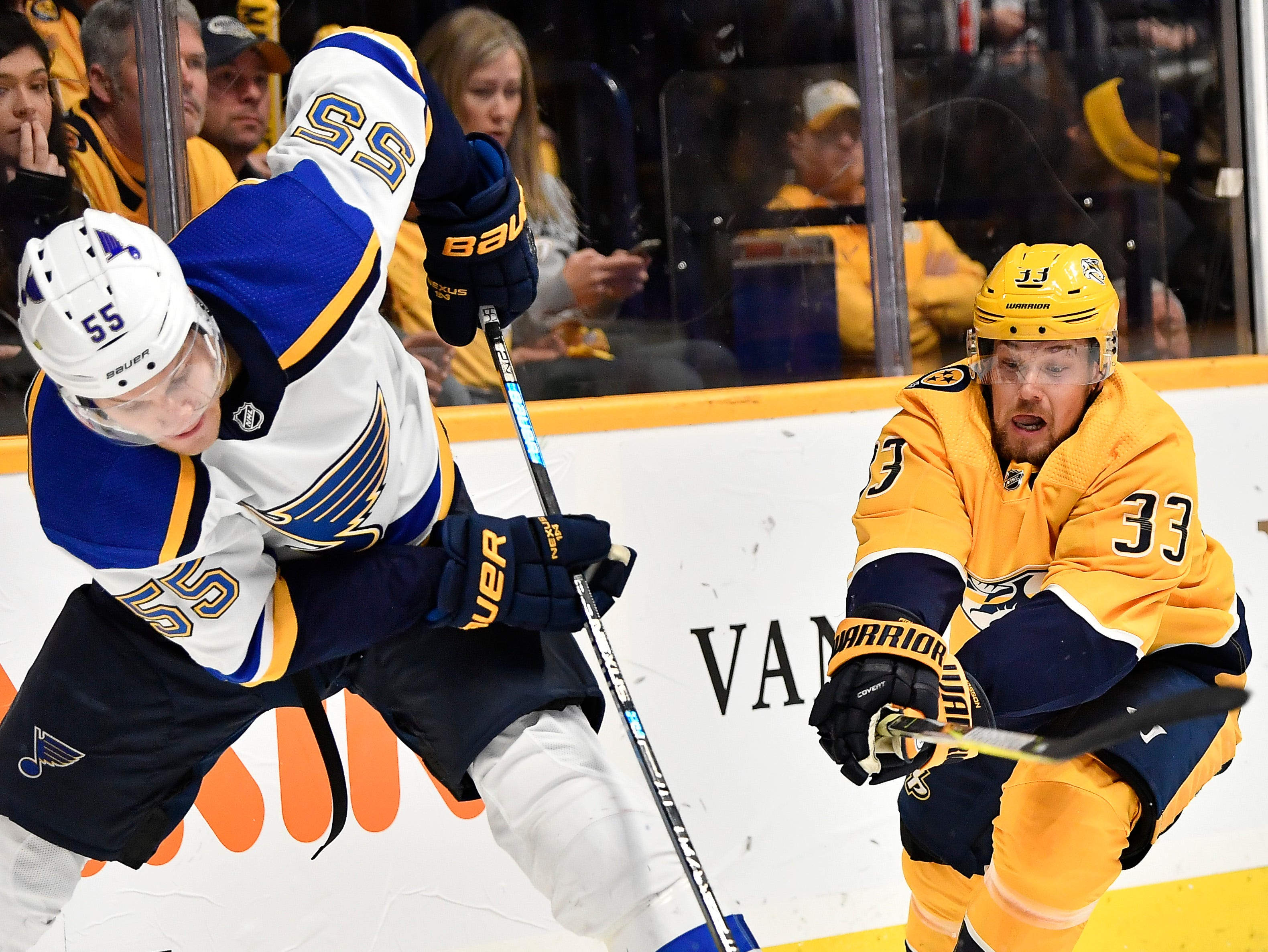 Predators right wing Viktor Arvidsson (33) dives for the puck against Blues defenseman Colton Parayko (55) during the first period at Bridgestone Arena Sunday Feb. 10, 2019 in Nashville, Tenn.