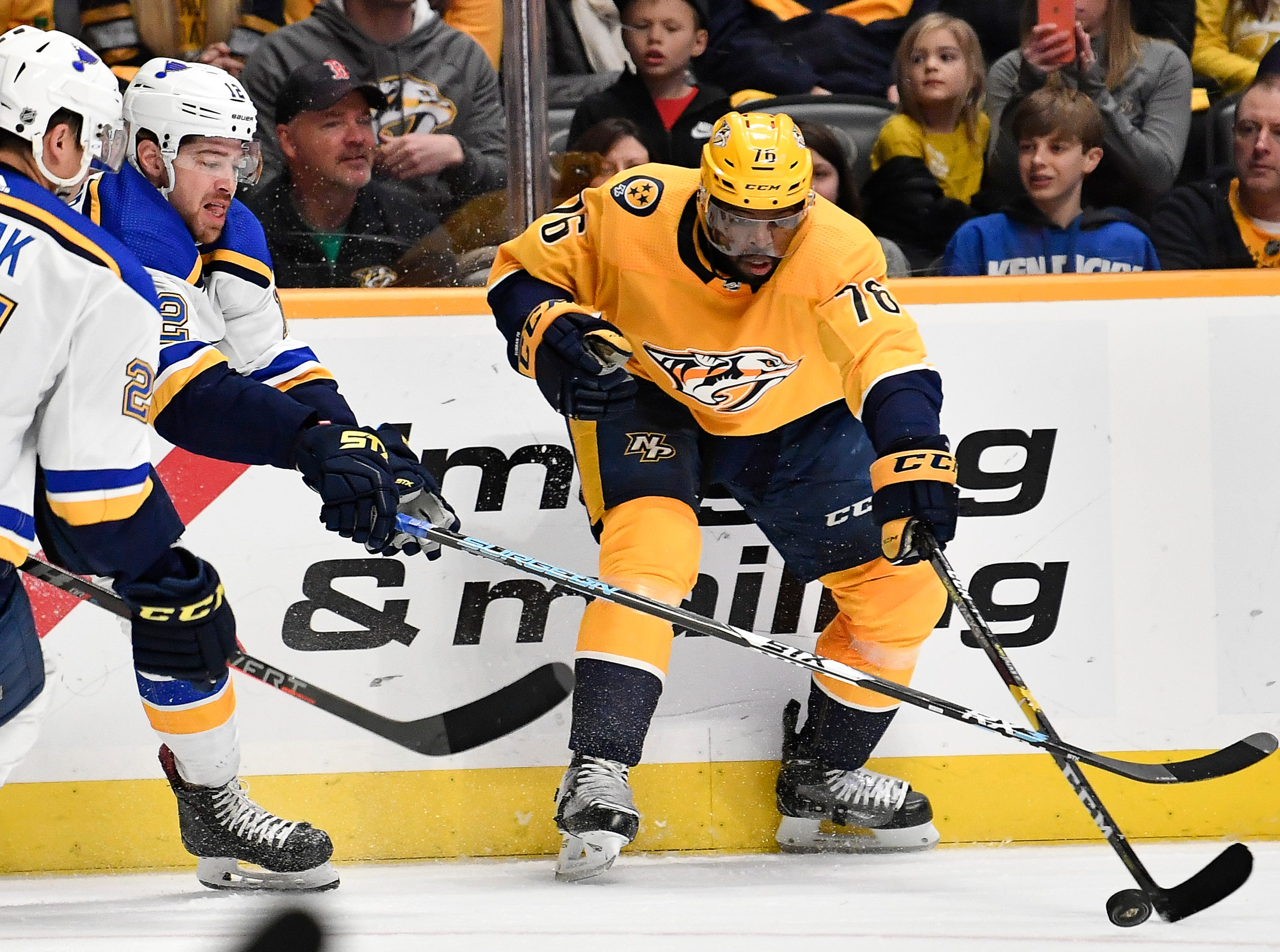 Predators defenseman P.K. Subban (76) reaches for the puck past Blues center Tyler Bozak (21) and left wing Zach Sanford (12) during the first period at Bridgestone Arena Sunday Feb. 10, 2019 in Nashville, Tenn.