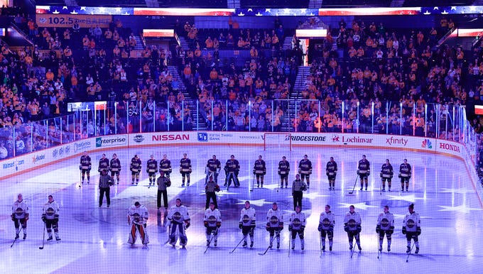 NWHL All Stars stand for the National Anthem before their game at Bridgestone Arena Sunday Feb. 10, 2019 in Nashville, Tenn.