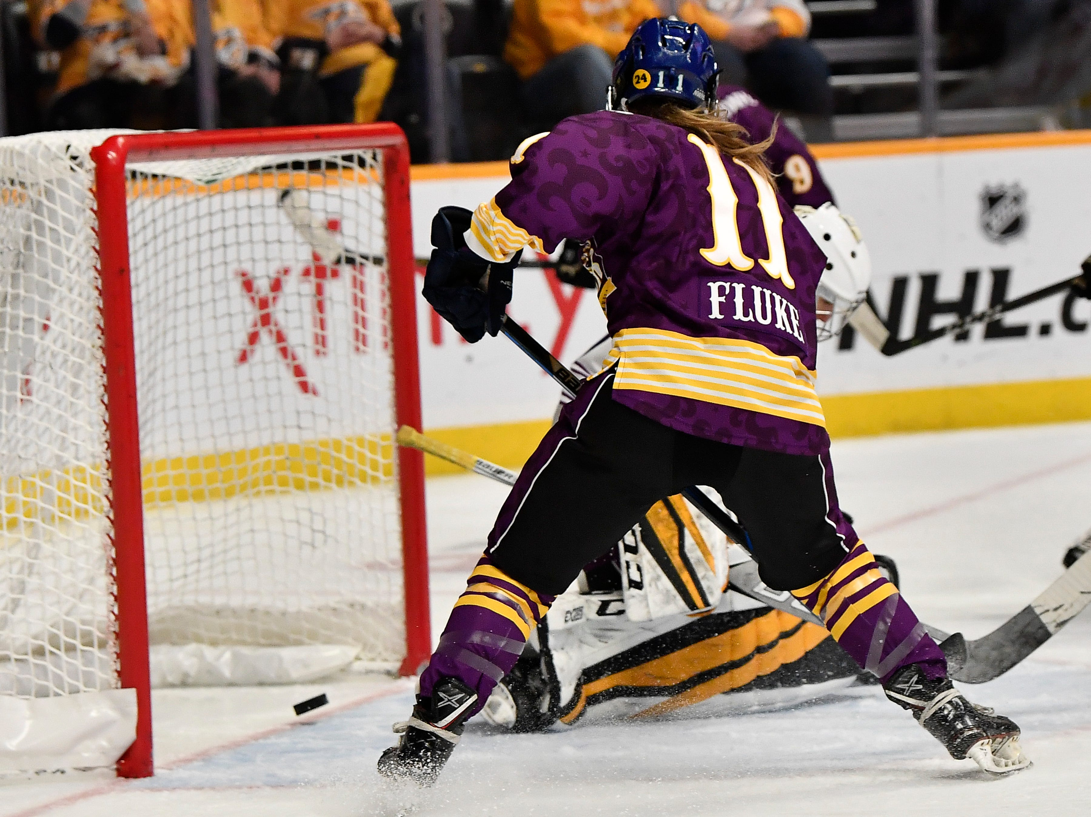 Team Stecklein's Emily Fluke scores a goal past Team Szabados goalie Katie Burt during the second half of the NWHL All Star game at Bridgestone Arena Sunday Feb. 10, 2019 in Nashville, Tenn.