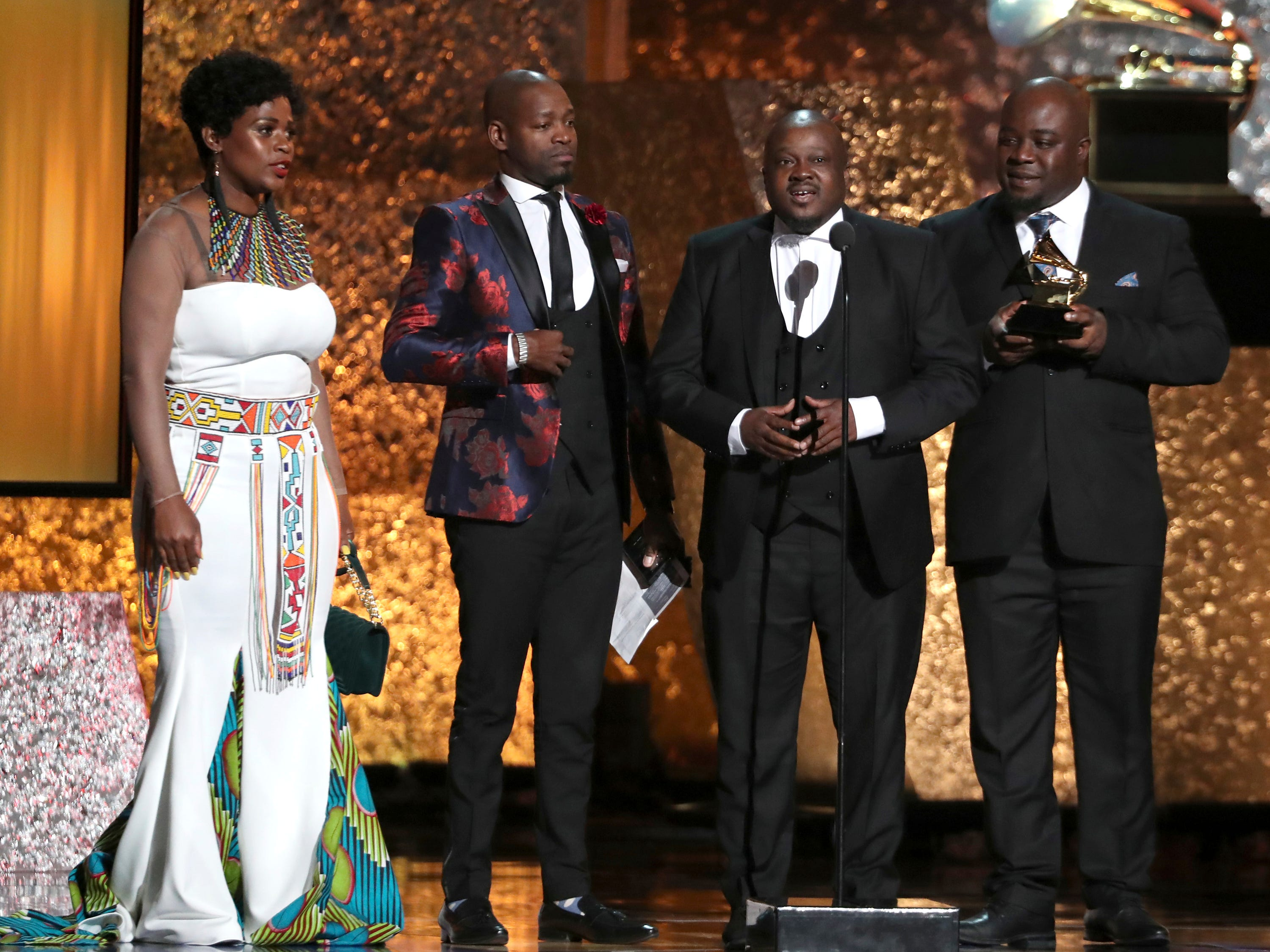 "Soweto Gospel Choir accept the award for best world music album for ""Freedom"" at the 61st annual Grammy Awards on Sunday, Feb. 10, 2019, in Los Angeles."
