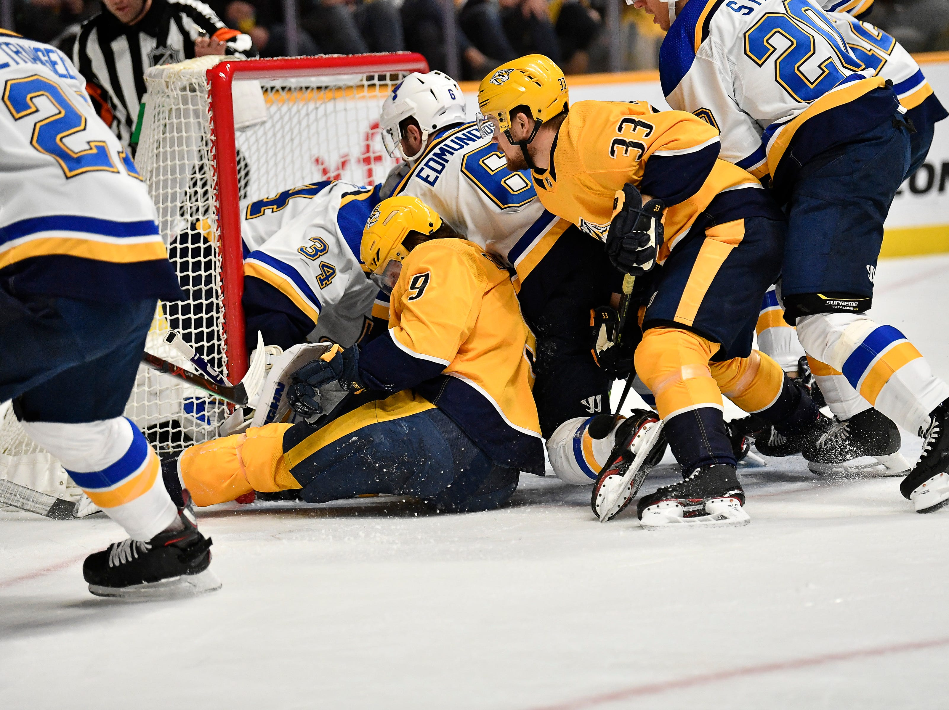Predators left wing Filip Forsberg (9) and right wing Viktor Arvidsson (33) crash the Blues net during the first period at Bridgestone Arena Sunday Feb. 10, 2019 in Nashville, Tenn.