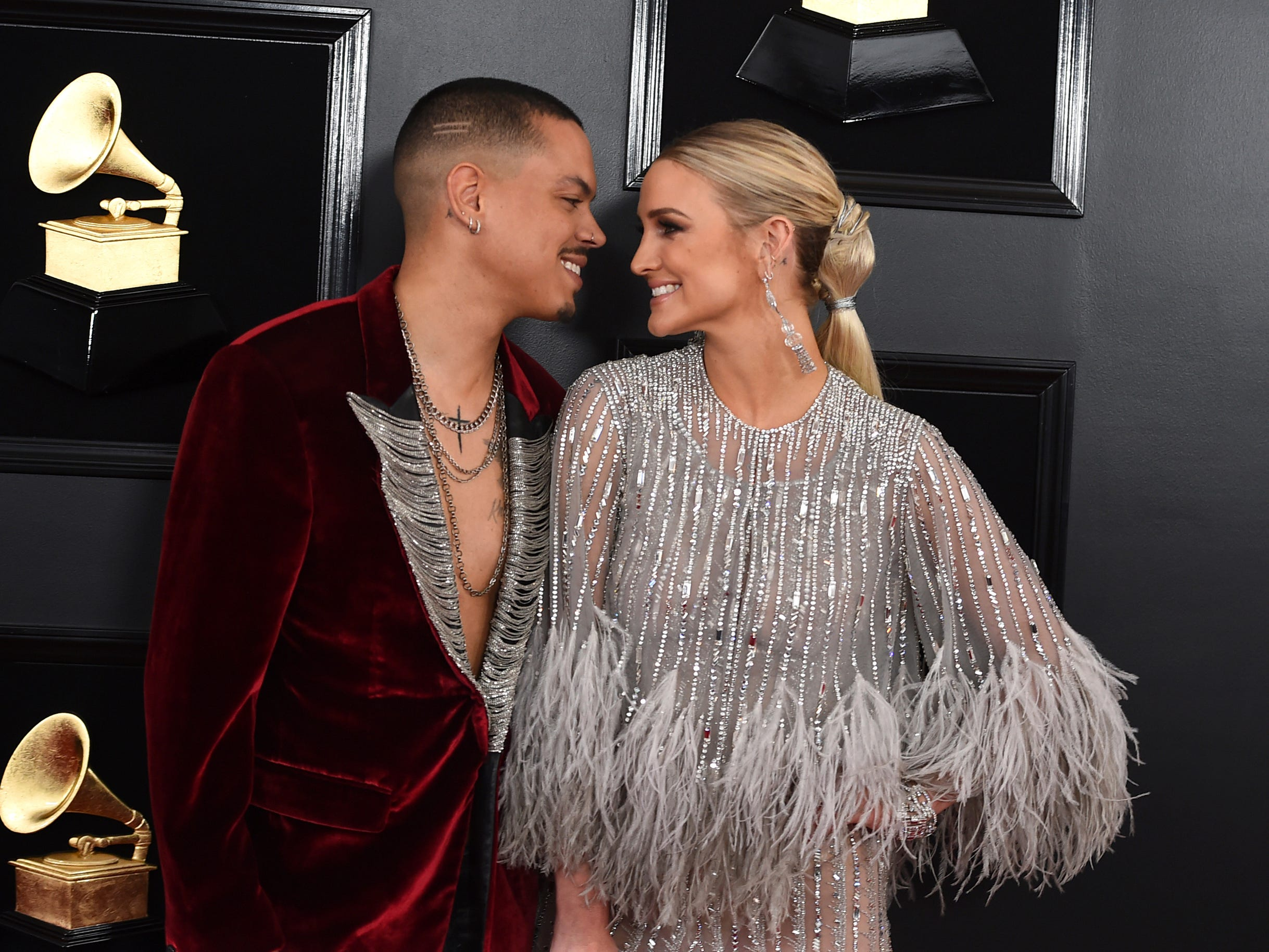 Evan Ross, left, and Ashlee Simpson arrive at the 61st annual Grammy Awards at the Staples Center on Sunday, Feb. 10, 2019, in Los Angeles.
