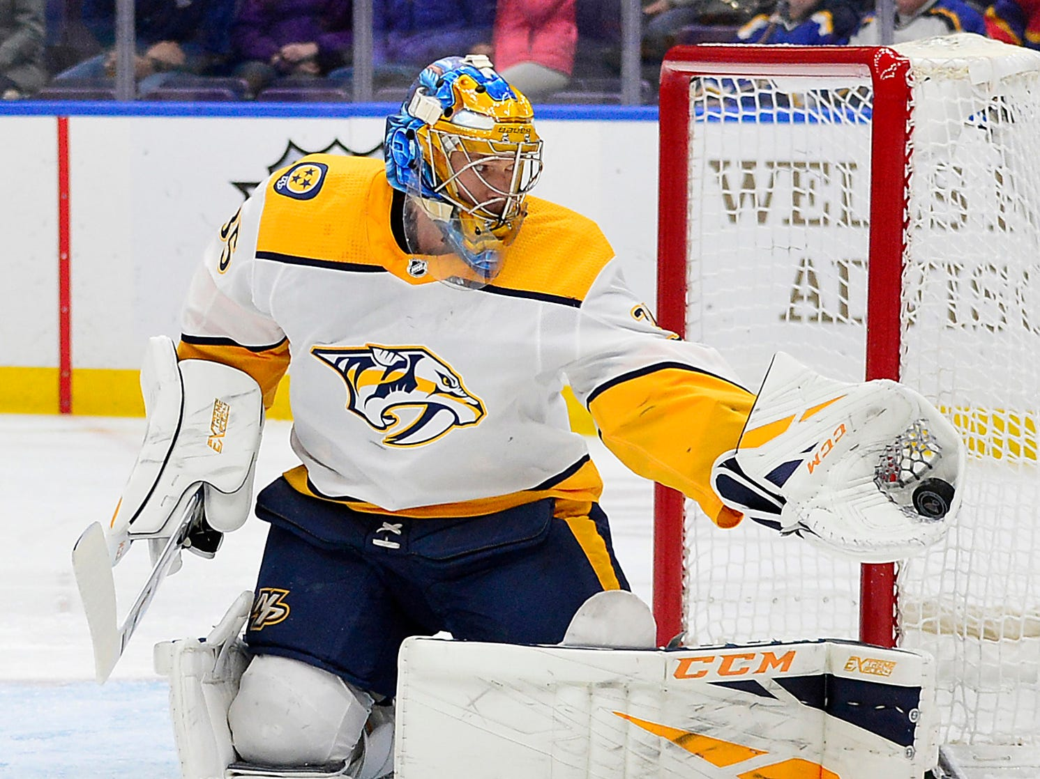 Nashville Predators goaltender Pekka Rinne (35) makes a glove save during the first period against the St. Louis Blues at Enterprise Center.