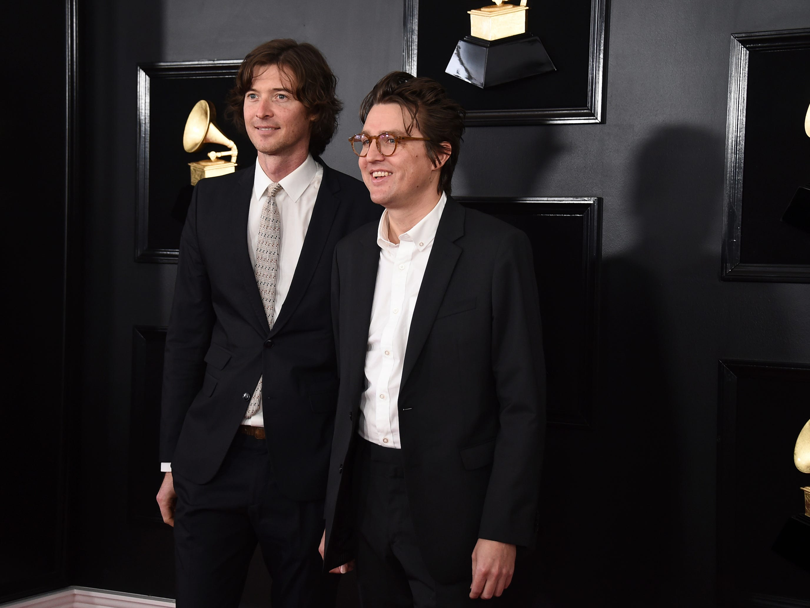 "Joey Ryan, left, and Kenneth Pattengale of ""The Milk Carton Kids"" arrive at the 61st annual Grammy Awards at the Staples Center on Sunday, Feb. 10, 2019, in Los Angeles."