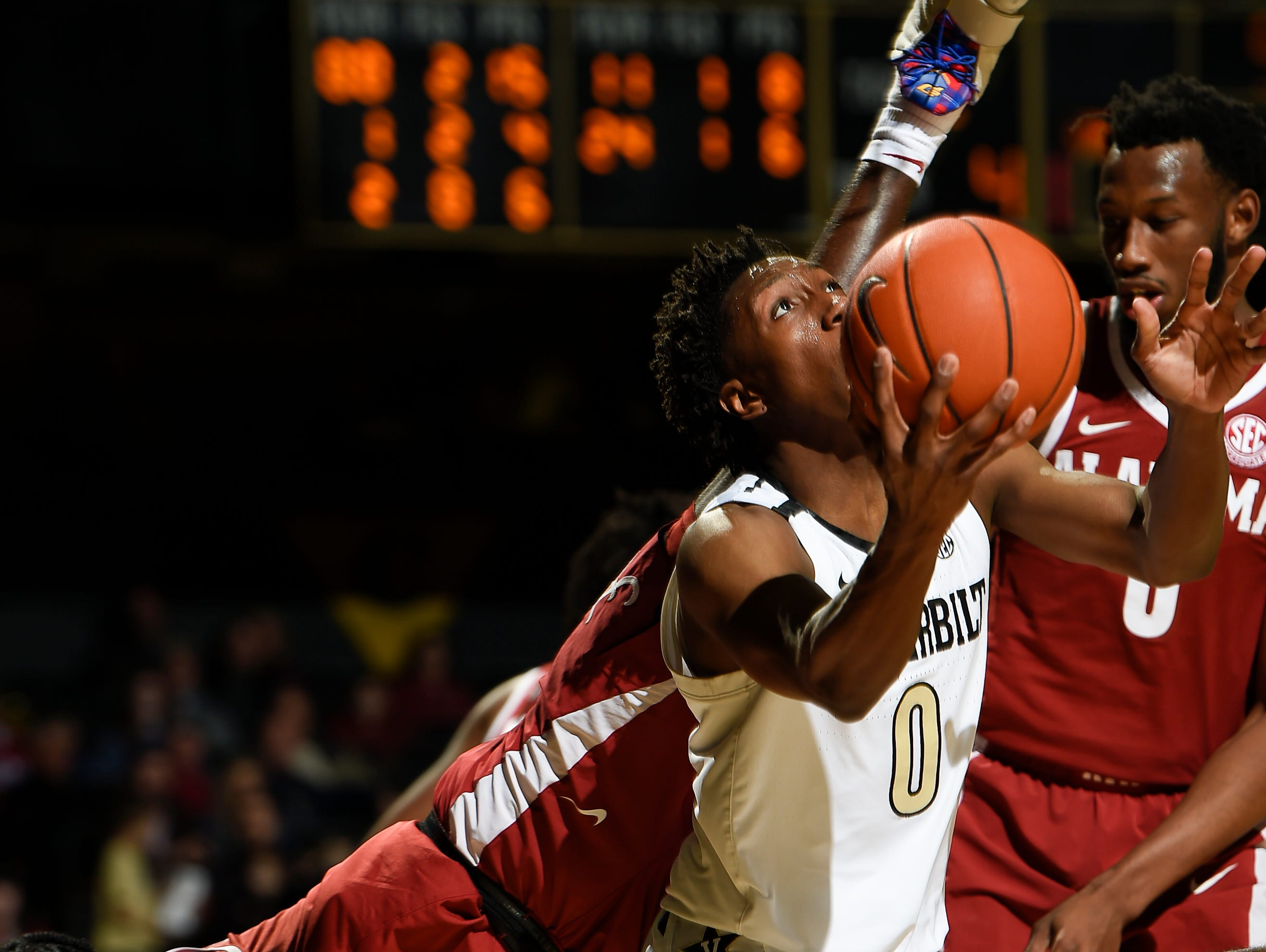 Vanderbilt guard Saben Lee (0) shoots as Alabama guard Kira Lewis Jr. (2) falls to the court during the second half at Memorial Gym Saturday Feb. 9, 2019 in Nashville, Tenn.