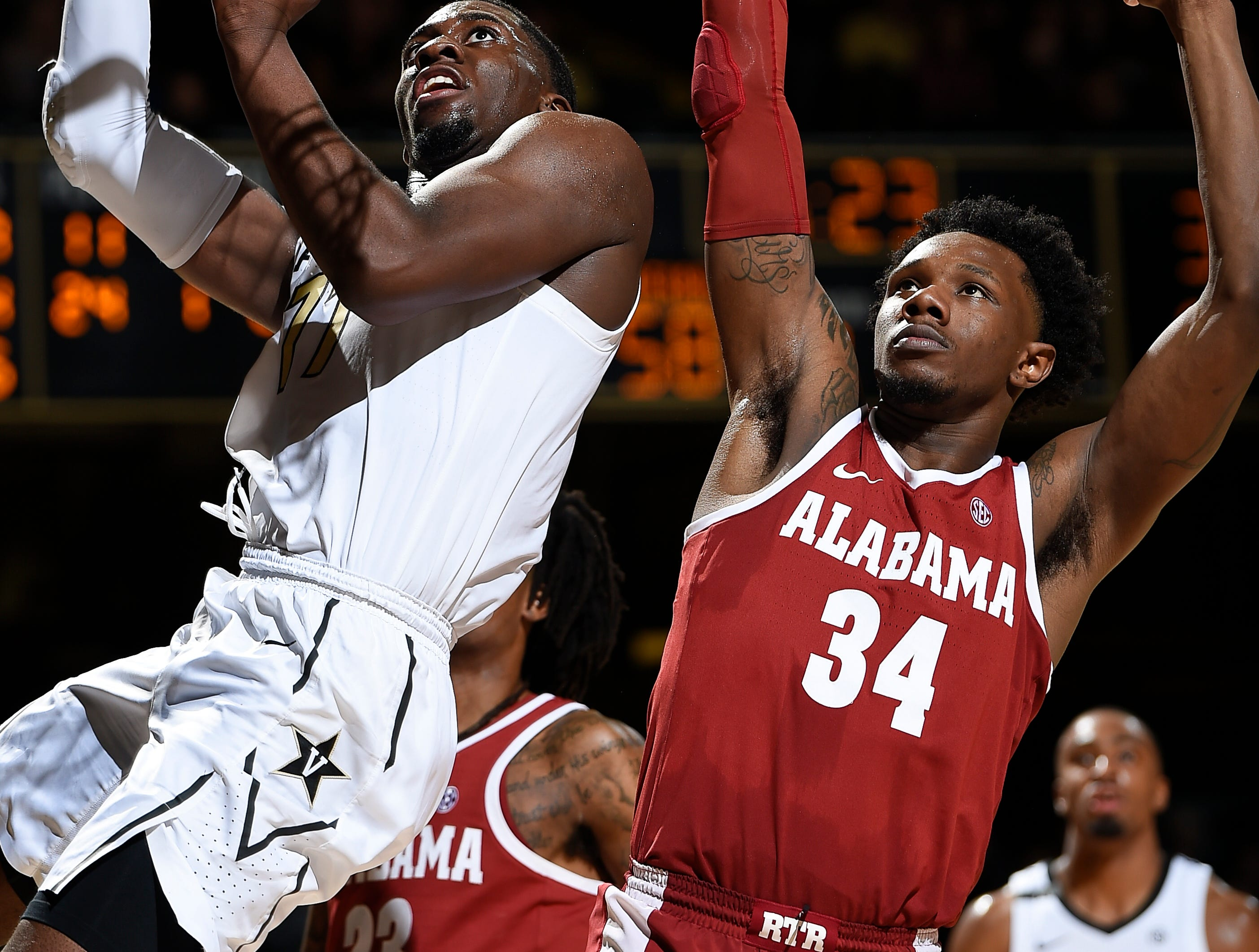 Vanderbilt forward Simisola Shittu (11) shoots over Alabama guard Tervin Mack (34) during the second half at Memorial Gym Saturday Feb. 9, 2019 in Nashville, Tenn.