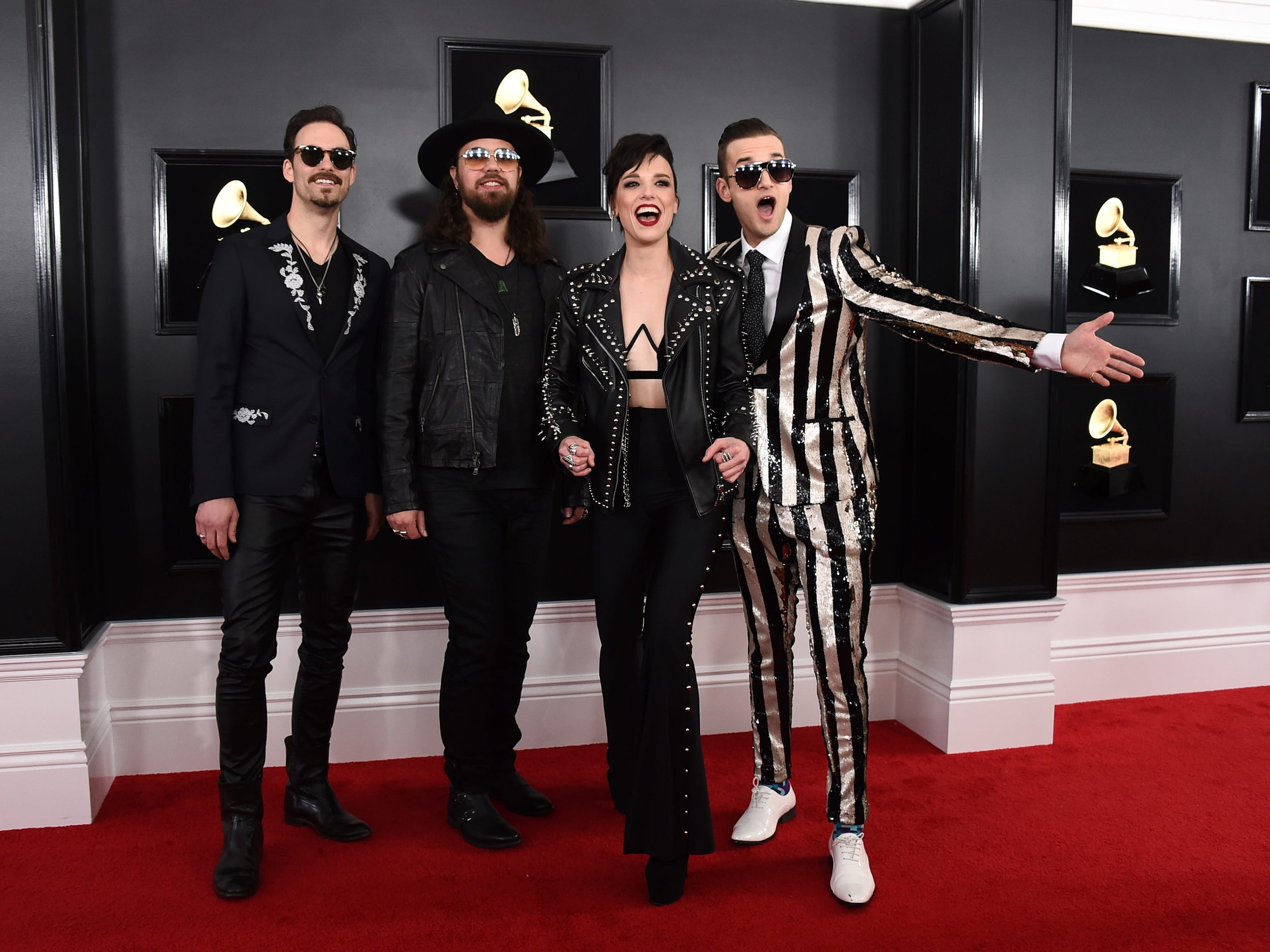 Josh Smith, from left, Joe Hottinger, Lzzy Hale, and Arejay Hale of Halestorm arrive at the 61st annual Grammy Awards at the Staples Center on Sunday, Feb. 10, 2019, in Los Angeles.