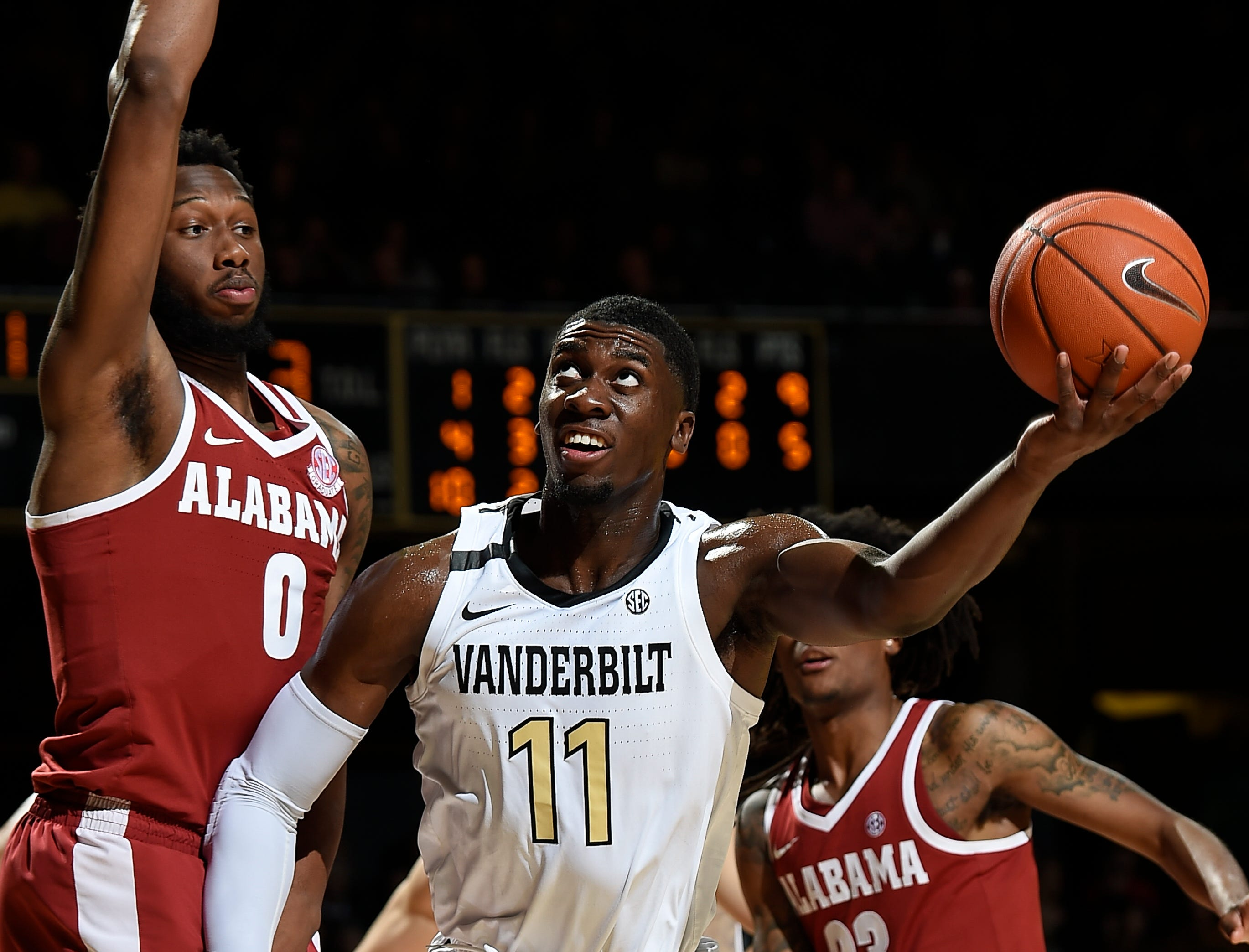 Vanderbilt forward Simisola Shittu (11) shoots past Alabama forward Donta Hall (0) during the second half at Memorial Gym Saturday Feb. 9, 2019 in Nashville, Tenn.