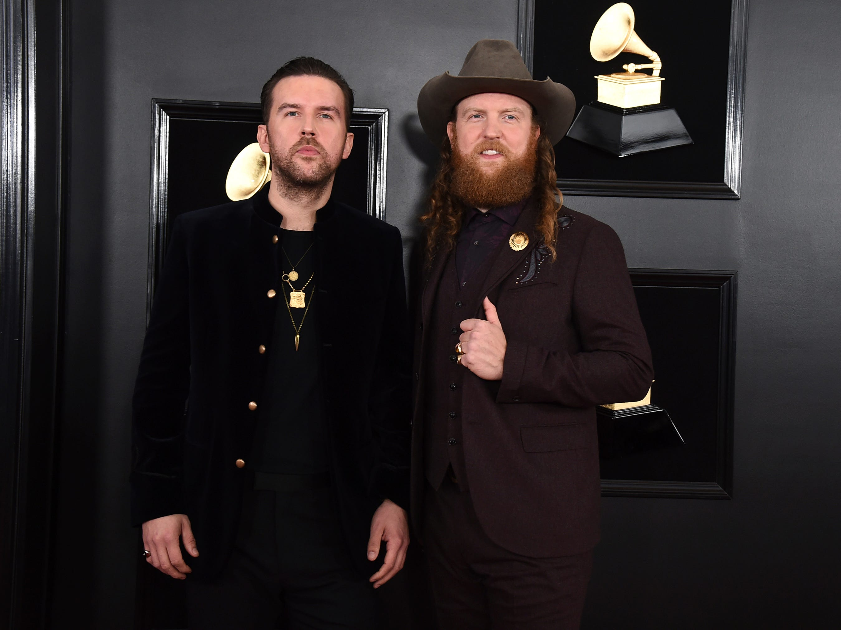 T.J. Osborne, left, and John Osborne of Brothers Osborne arrive at the 61st annual Grammy Awards at the Staples Center on Sunday, Feb. 10, 2019, in Los Angeles.