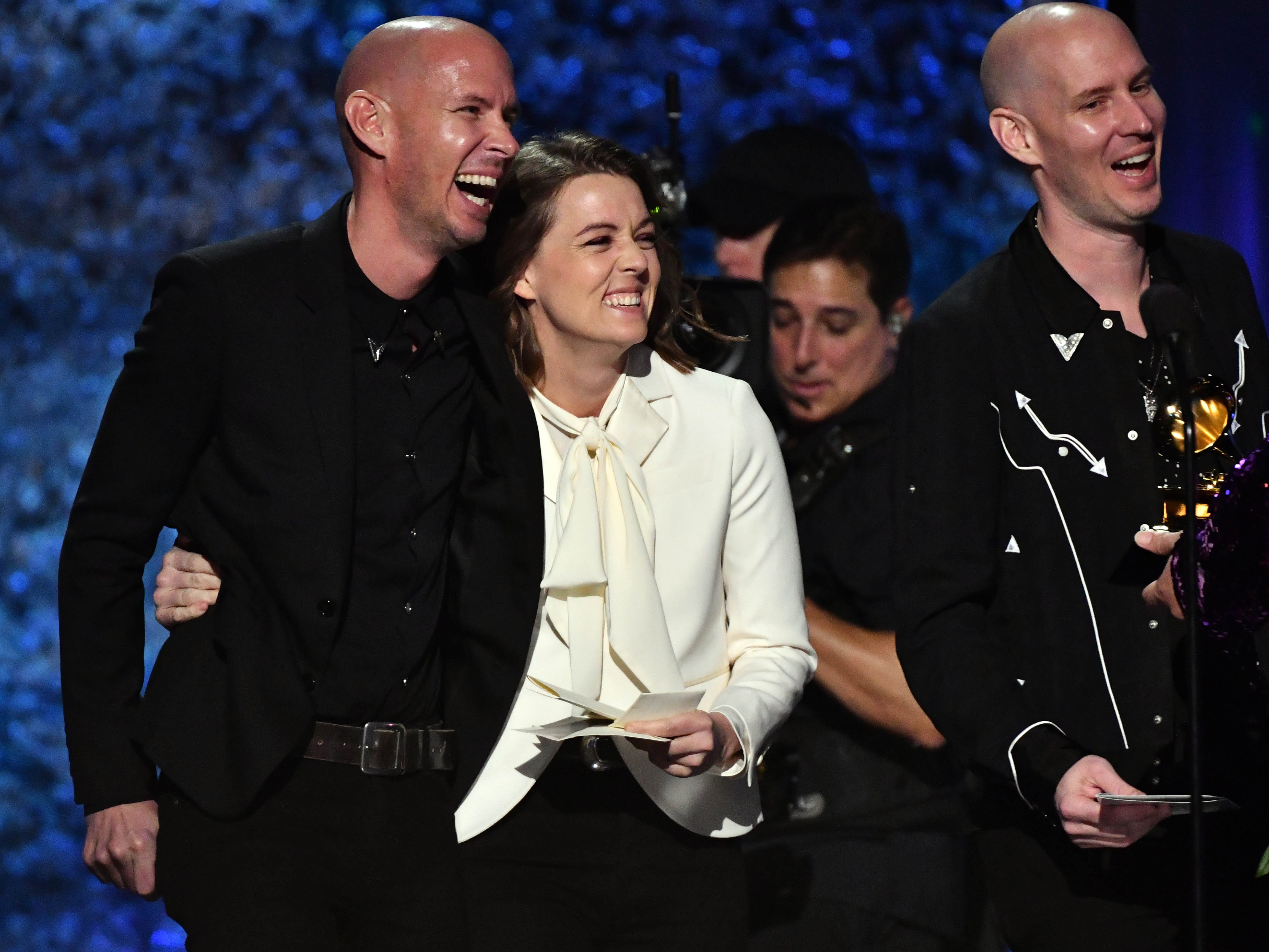 Phil Hanseroth (L), Brandi Carlile and Tim Hanseroth accept the award for  Best Americana Album for Brandi Carlile's By The Way, I Forgive You at the GRAMMY Awards Premiere Ceremony at the Microsoft Theater in Los Angeles, Calif.