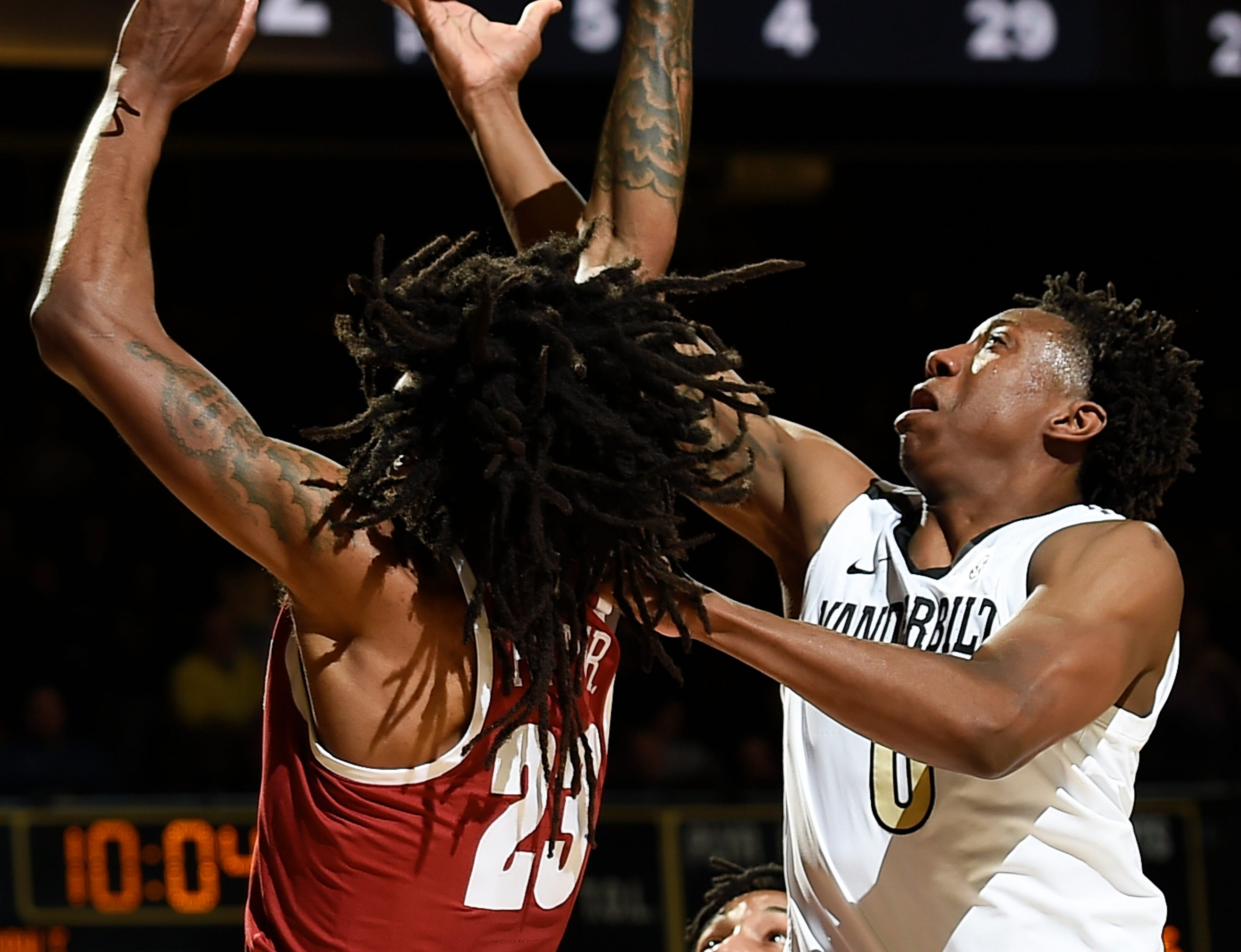Vanderbilt guard Saben Lee (0) shoots over Alabama guard John Petty (23) during the second half at Memorial Gym Saturday Feb. 9, 2019 in Nashville, Tenn.