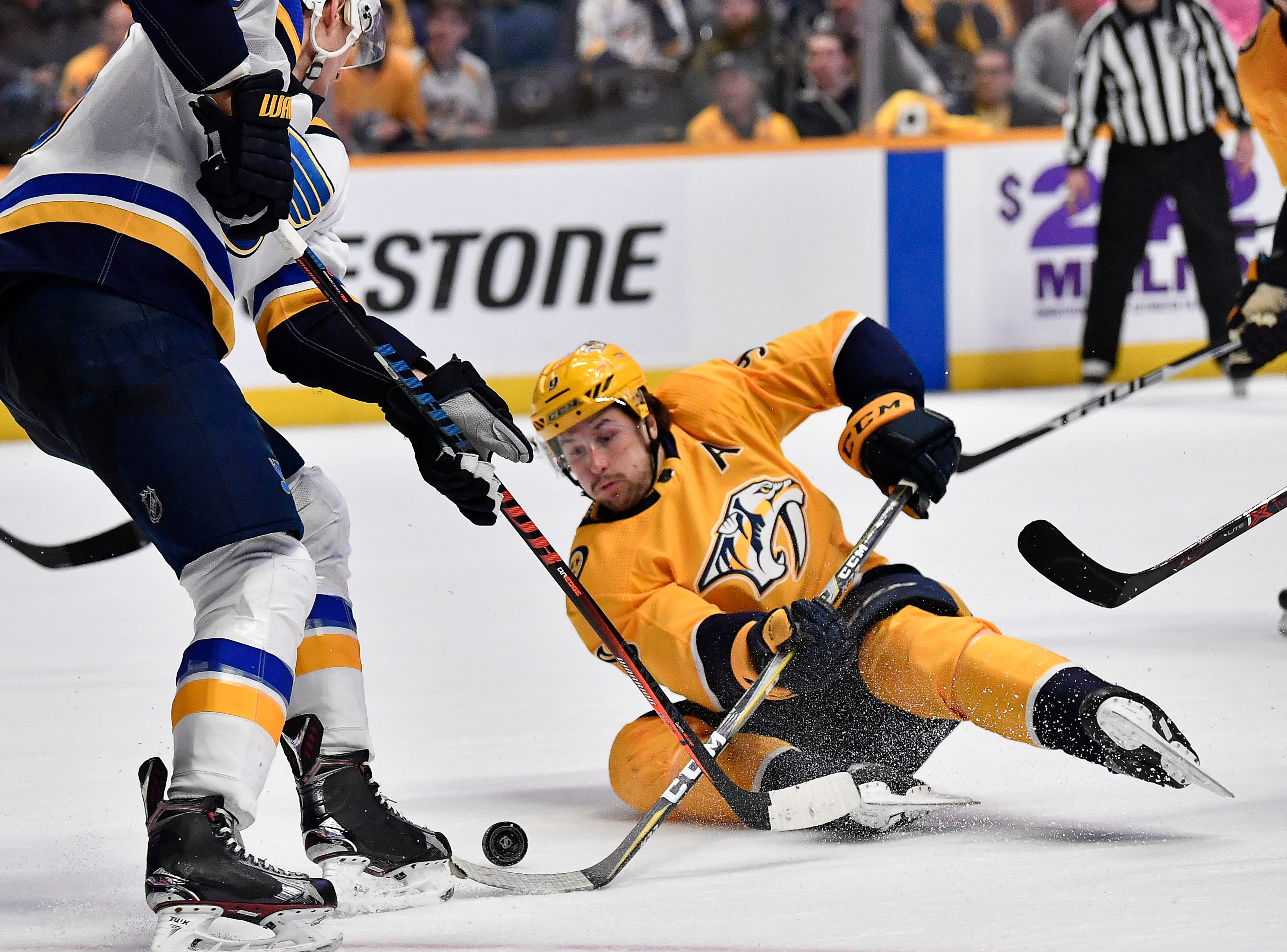 Predators left wing Filip Forsberg (9) shoots the puck past a Blues defender during the third period at Bridgestone Arena Sunday Feb. 10, 2019 in Nashville, Tenn.