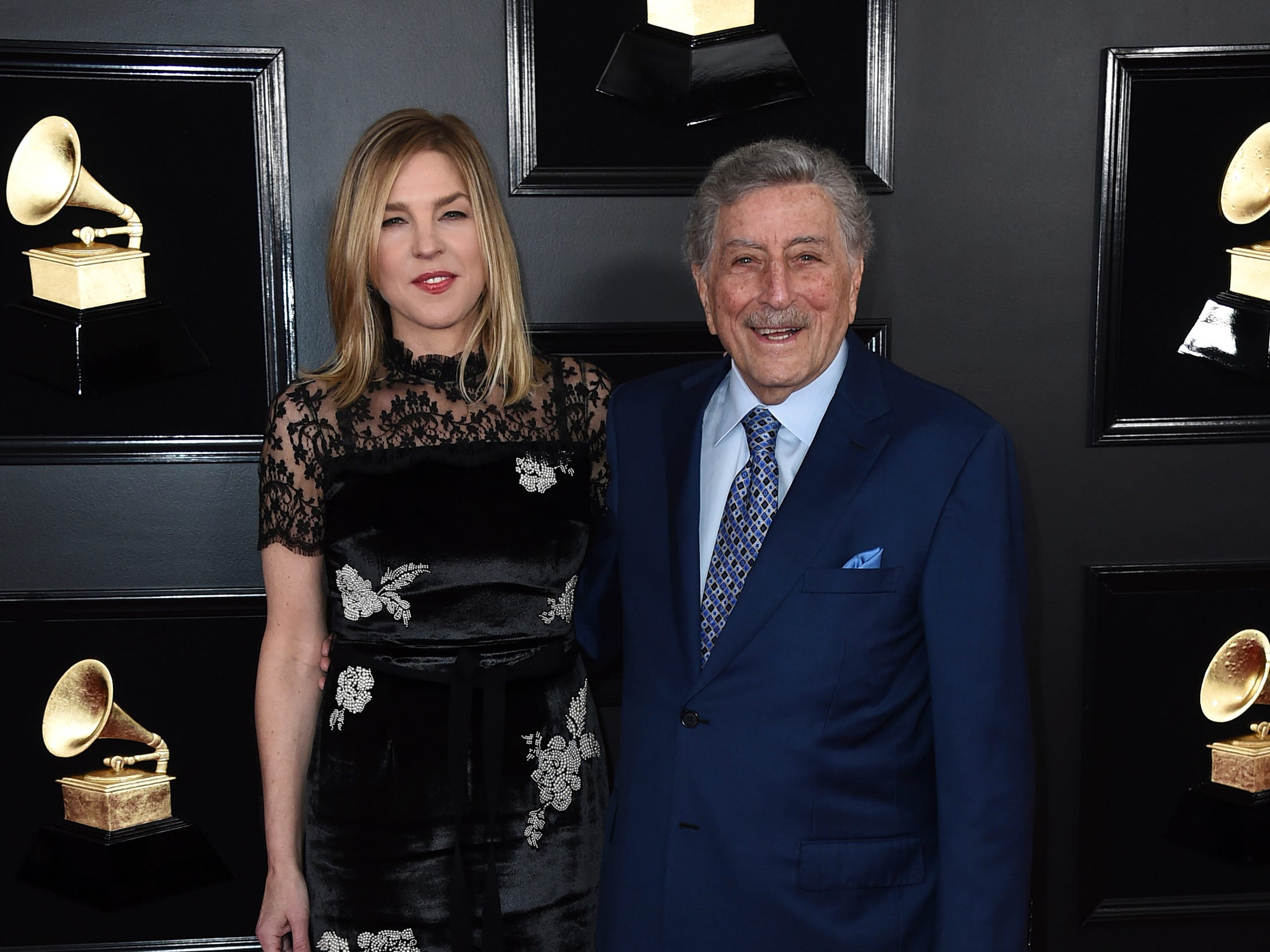 Diana Krall, left, and Tony Bennett arrive at the 61st annual Grammy Awards at the Staples Center on Sunday, Feb. 10, 2019, in Los Angeles.