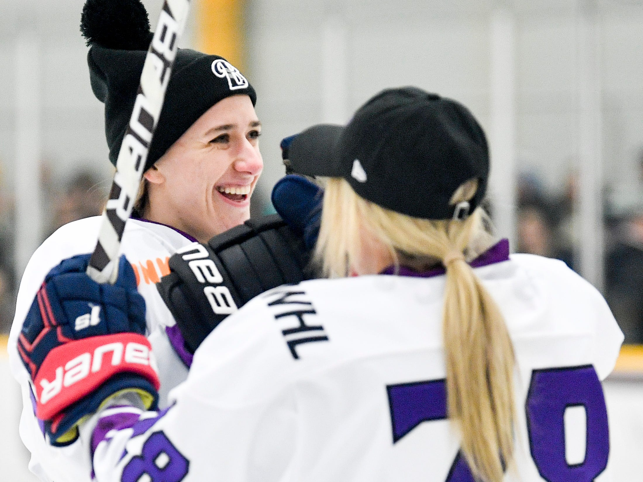 Hayley Scamurra, left, reacts with Amanda Kessel after competing in the shooting accuracy competition during the 2019 NWHL All-Star Weekend Skills Competition at Ford Ice Center in Antioch, Tenn., Saturday, Feb. 9, 2019.