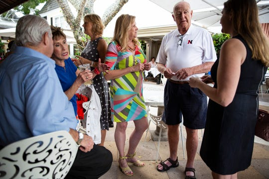 Nancy Dagher, center, and Juliana Meek, right, both of whom are 5-foot-11, try to recruit Warren Delaney to join their club, Tall Friends of Southwest Florida, during a group outing at Campiello in Naples on Sunday, Feb. 10, 2019. The club has a minimum height requirement of 5 feet, 10 inches for women and 6 feet, 2 inches for men.
