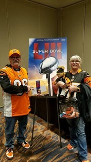 Granville couple Kent and Jenny Davis pick up their Super Bowl LIII tickets after arriving in Atlanta earlier this month. They have attended 101 consecutive Bengals regular season and postseason games.