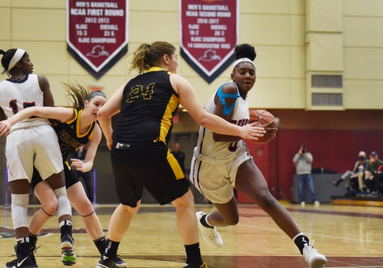 Jaida Patrick (no.3) of Saddle River Day makes a move and tries to past Alexandra Hartman (no. 24) of Paramus Catholic in the first half during the 2019 Bergen County girls basketball championship semifinal at Ramapo College in Mahwah on 02/10/19.
