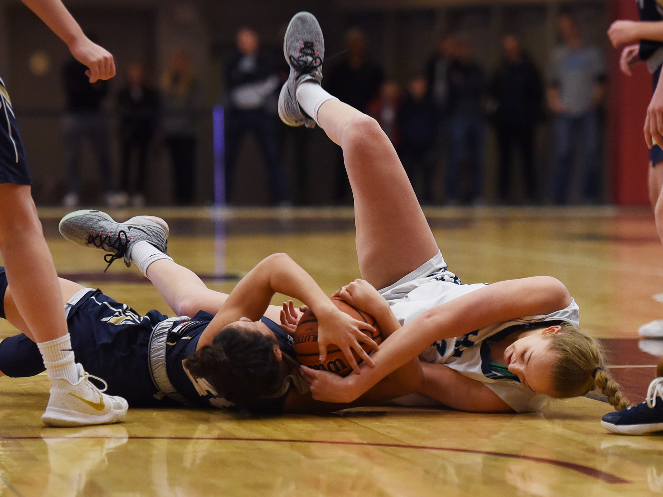 Anna Morris (no.42) of Immaculate Heart battles for a loose ball on the floor against Gianna Saccoccio (no.20) of NV/Old Tappan in the first half during the 2019 Bergen County girls basketball championship semifinal at Ramapo College in Mahwah on 02/10/19.