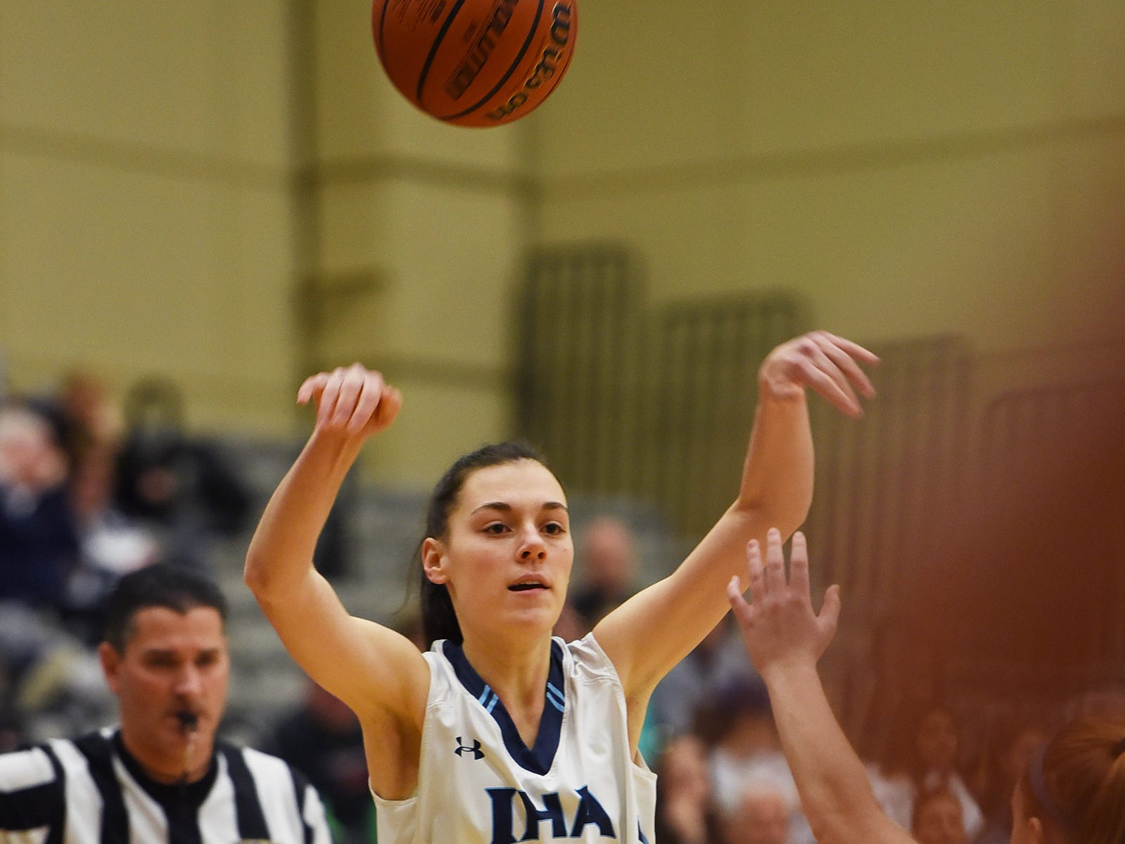 Lexi Edmonds (no. 24) of Immaculate Heart throws a pass against NV/Old Tappan in the first half during the 2019 Bergen County girls basketball championship semifinal at Ramapo College in Mahwah on 02/10/19.