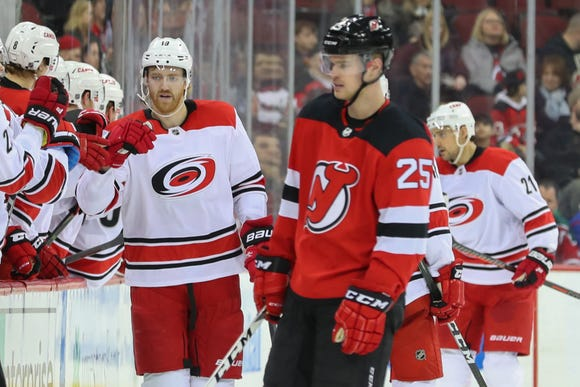 Feb 10, 2019; Newark, NJ, USA; Carolina Hurricanes defenseman Dougie Hamilton (19) celebrates with teammates goal during the second period against the New Jersey Devils at Prudential Center.