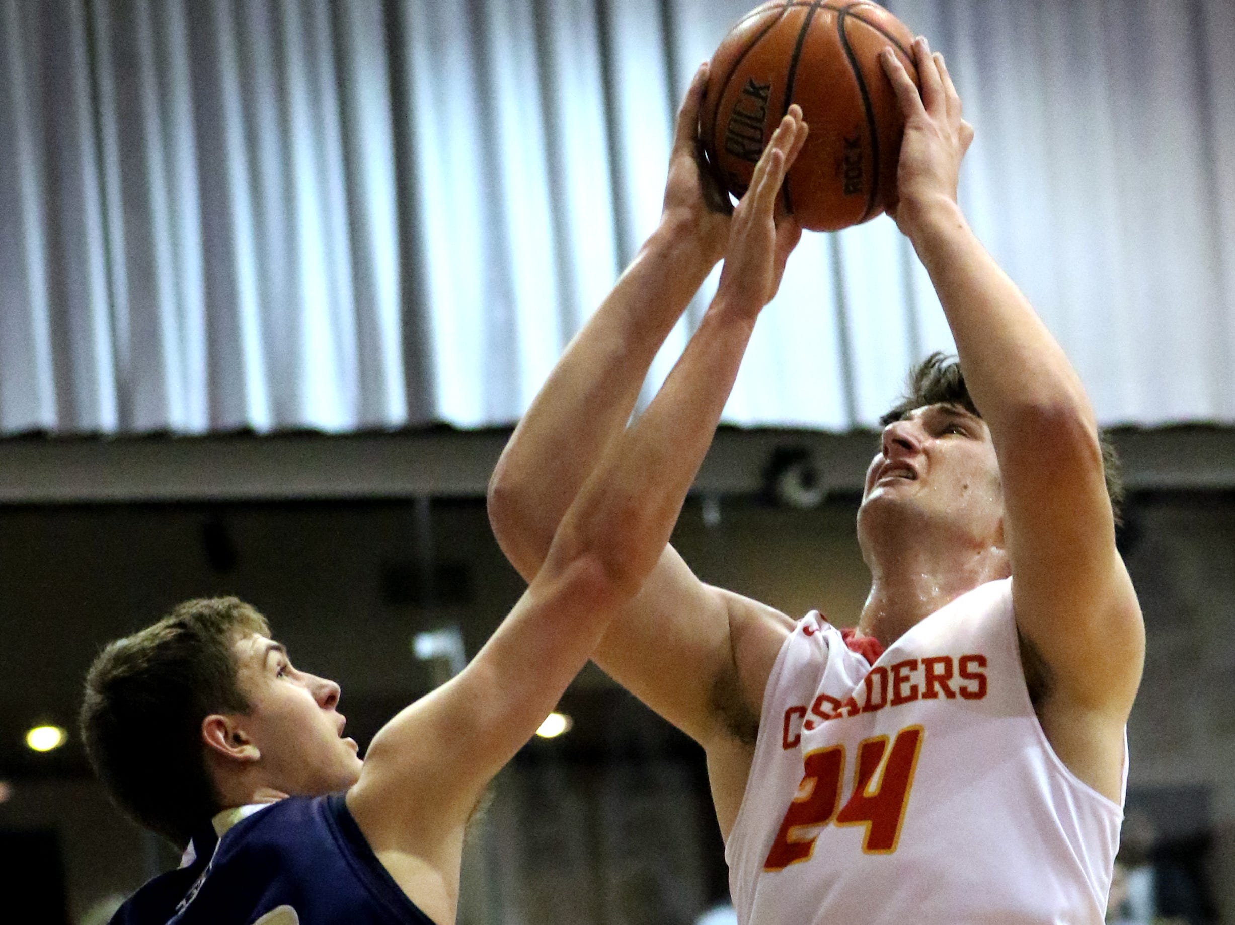 Matt Zona, of Bergen Catholic, goes for two against Steven Turk, of Ramsey.  The Crusaders went on to win, 60-50, at the Bergen County Jamboree.  Sunday, February 10, 2019