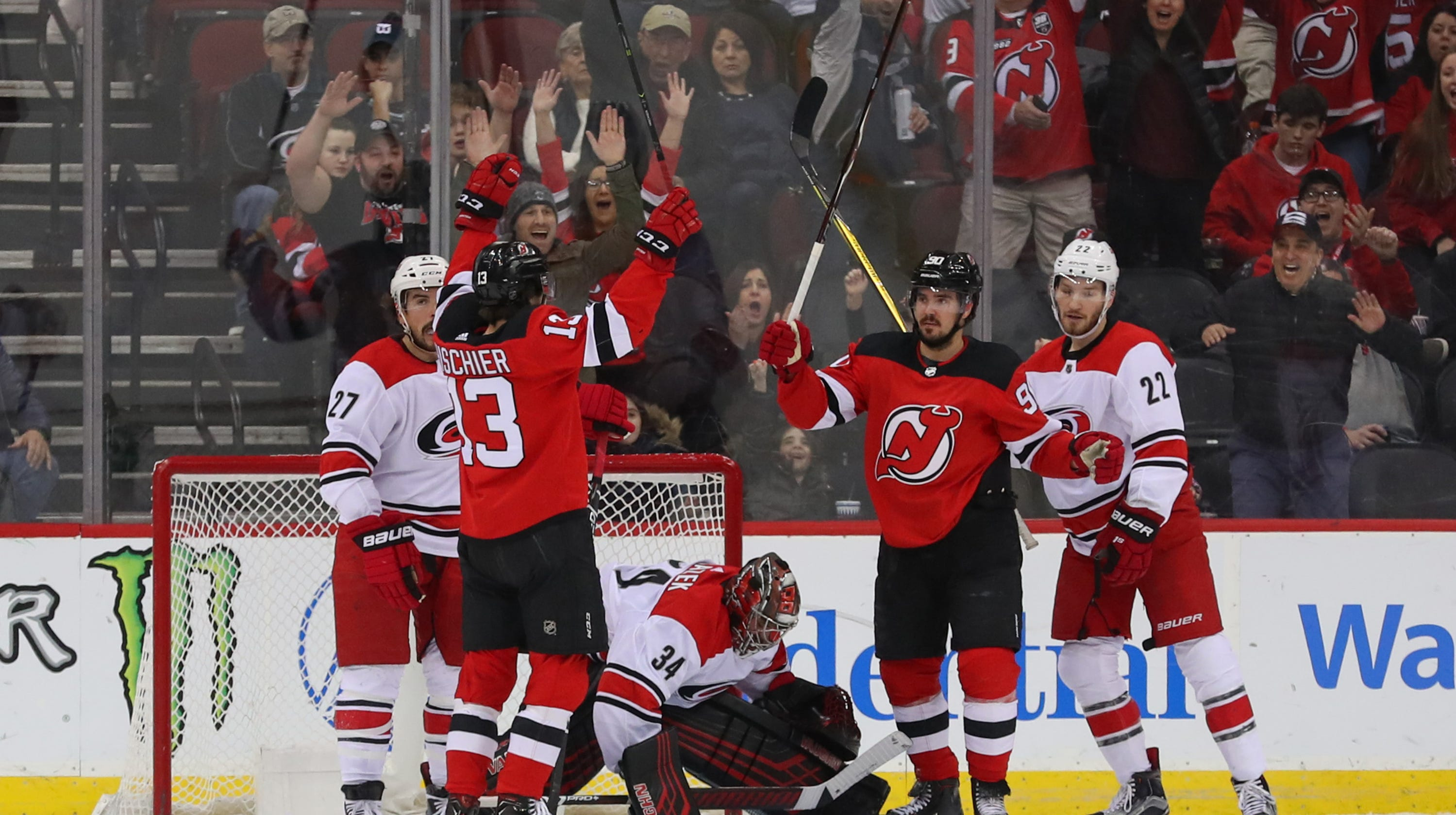 NJ Devils hold off hard-charging Hurricanes for 3-2 win 0420c39e9