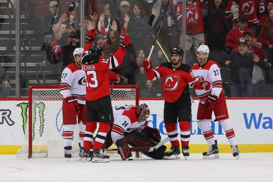 Feb 10, 2019; Newark, NJ, USA; New Jersey Devils left wing Marcus Johansson (90) celebrates after scoring a goal during the first period of their game against the Carolina Hurricanes at Prudential Center.