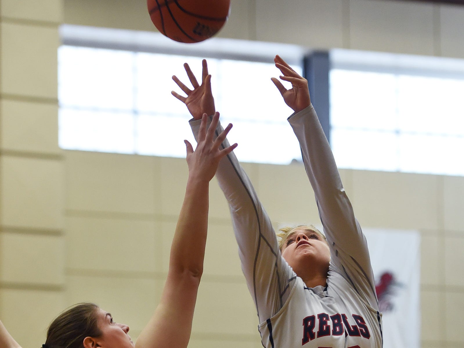 Jenna Jordan (no.33) of Saddle River Day makes a shot over Alexandra Hartman (no.24) of Paramus Catholic in the first half during the 2019 Bergen County girls basketball championship semifinal at Ramapo College in Mahwah on 02/10/19.
