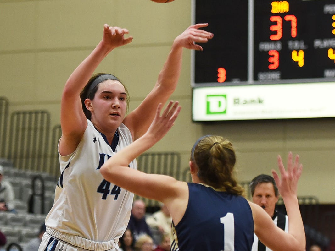 Emma Matesic (no. 44) of Immaculate Heart throws a pass over the head of Halie Plescia (no. 1) of NV/Old Tappan in the second half during the 2019 Bergen County girls basketball championship semifinal at Ramapo College in Mahwah on 02/10/19.
