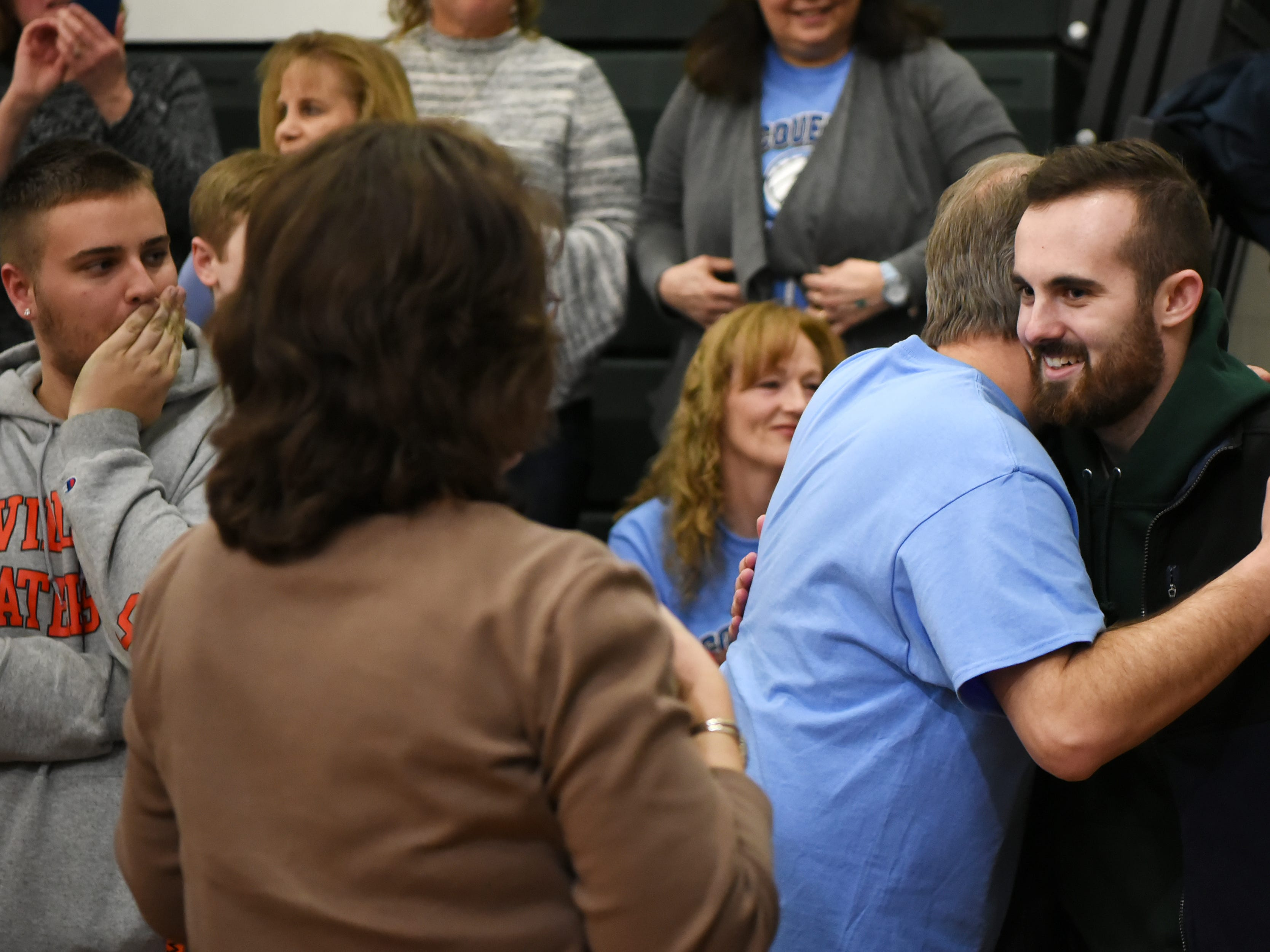 A fundraising Volleyball Tournament is held at Midland Park High School in Midland Park on Saturday February 9, 2019. The event is to raise money for the families of two young people seriously injured in an auto accident in December. Ryan Moore, who was injured in the accident, is greeted by his Father, Eric Moore as he arrives at the gym.