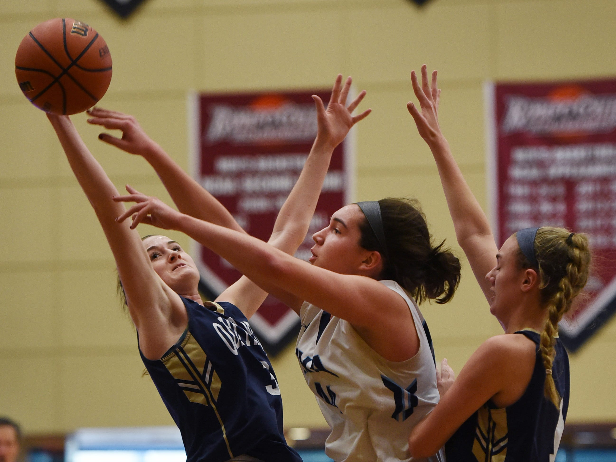 Emma Matesic (no. 44) of Immaculate Heart battles for the loose ball against Noelle Gonzalez (no. 3) of NV/Old Tappan in the first half during the 2019 Bergen County girls basketball championship semifinal at Ramapo College in Mahwah on 02/10/19.