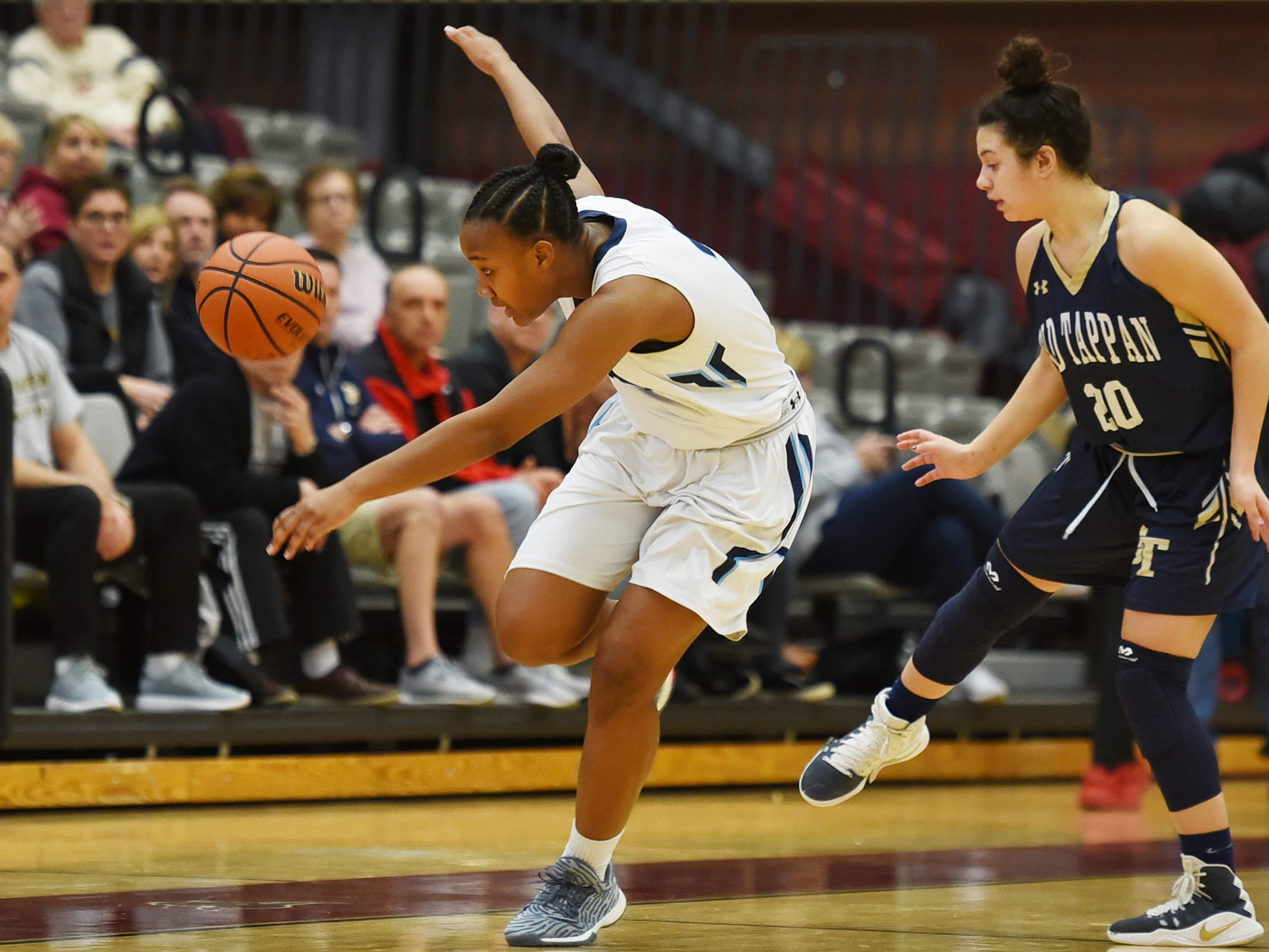 Eliya Herriott (no.2) of Immaculate Heart looses her balance and control of the ball as she passed Gianna Saccoccio (no. 2) of NV/Old Tappan in the second half during the 2019 Bergen County girls basketball championship semifinal at Ramapo College in Mahwah on 02/10/19.