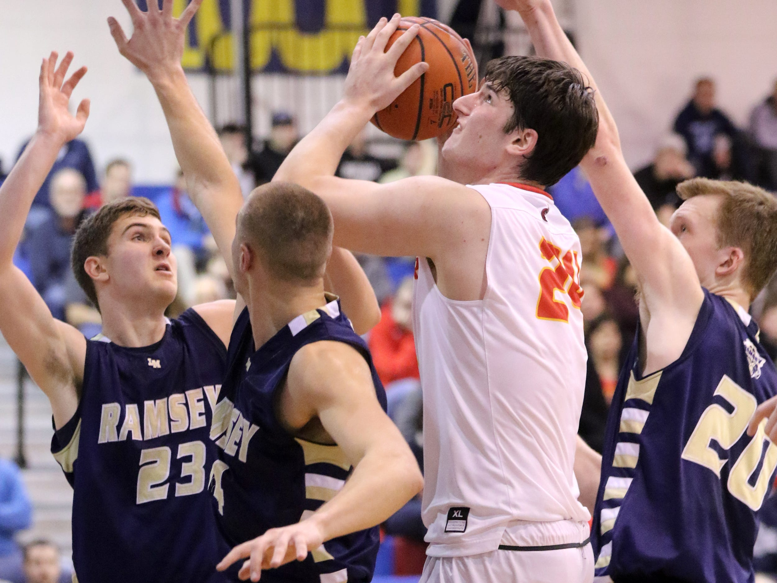 Matt Zona, of Bergen Catholic, eyes the hoop as he is surrounded by Ramsey defense.  Sunday, February 10, 2019