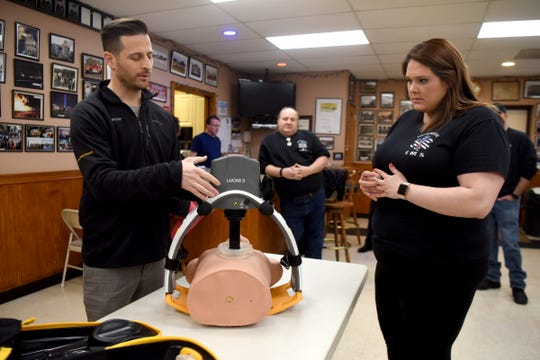 "Members of the East Rutherford EMS squad, including Lt. Alexis Harden, receive a demonstration of ""Lucas,"" a mechanical chest compression machine by Ryan Pinnix. The EMS squad received the machine on Sunday, February 10, 2019 at the Grove St. Firehouse."