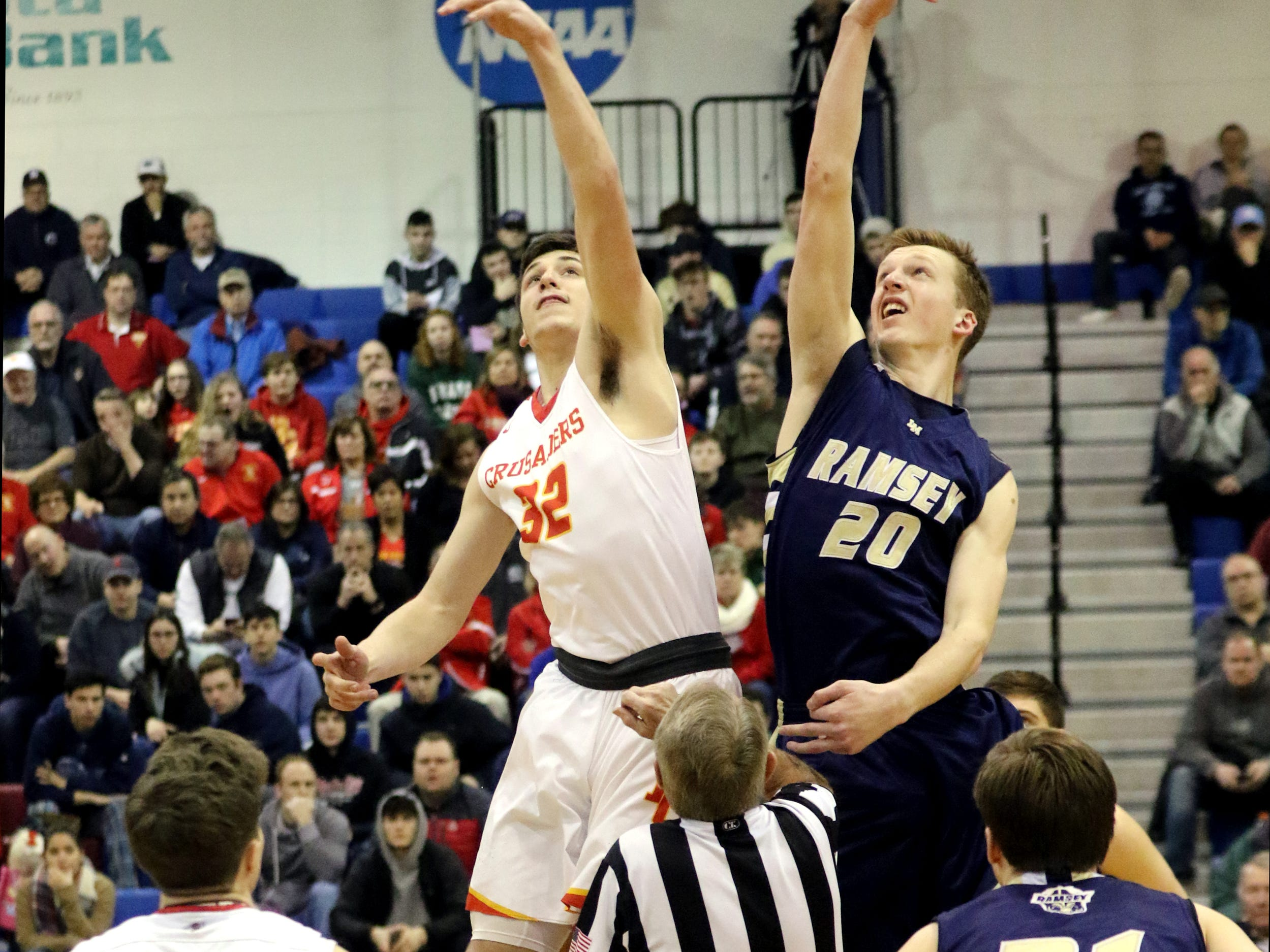 Zach Freemantle, of Bergen Catholic, wins the tip-off against Sean Hansen, of Ramsey.  Sunday, February 10, 2019