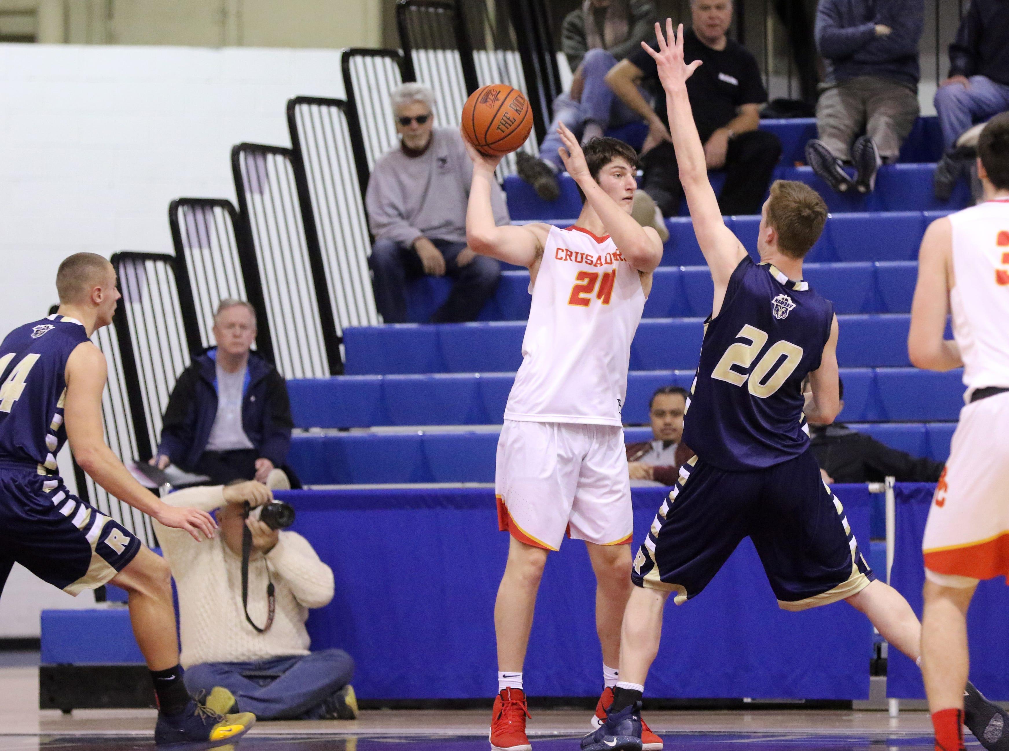 Matt Zona, of Bergen Catholic, tries to pass the ball through defense by Sean Hansen, of Ramsey. Sunday, February 10, 2019