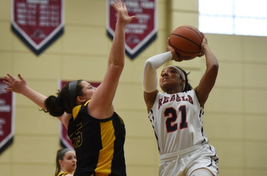 Sydnei Caldwell of Saddle River Day makes a shot over Julianna Kascic (no.55) of Paramus Catholic in the first half during the 2019 Bergen County girls basketball championship semifinal at Ramapo College in Mahwah on 02/10/19.