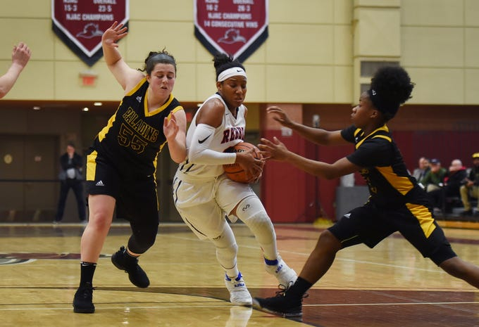 Sydnie Caldwell (no.21) of Saddle River Day makes her way past Julianna Kascic (no.55) and Janel Moore (no.3) of Paramus Catholic in the first half during the 2019 Bergen County girls basketball championship semifinal at Ramapo College in Mahwah on 02/10/19.