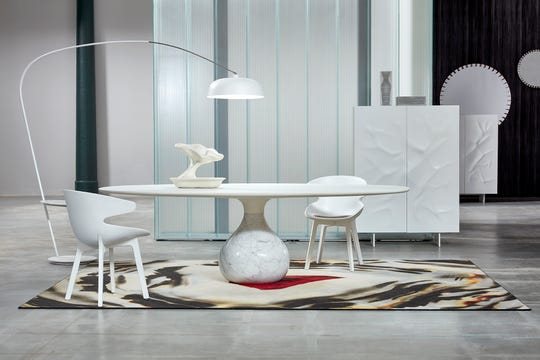The Les Contemporains collection from Roche Bobois features unique elements like the Aqua dining table with solid carrara or marble base, and SVEL polyester resin chairs.