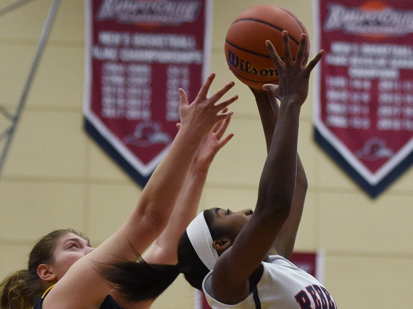 Jaayden Lafontant (no.15) of Saddle River Day makes a shot as Alexandra Hartman (no.24) of Paramus Catholic defends in the first half during the 2019 Bergen County girls basketball championship semifinal at Ramapo College in Mahwah on 02/10/19.